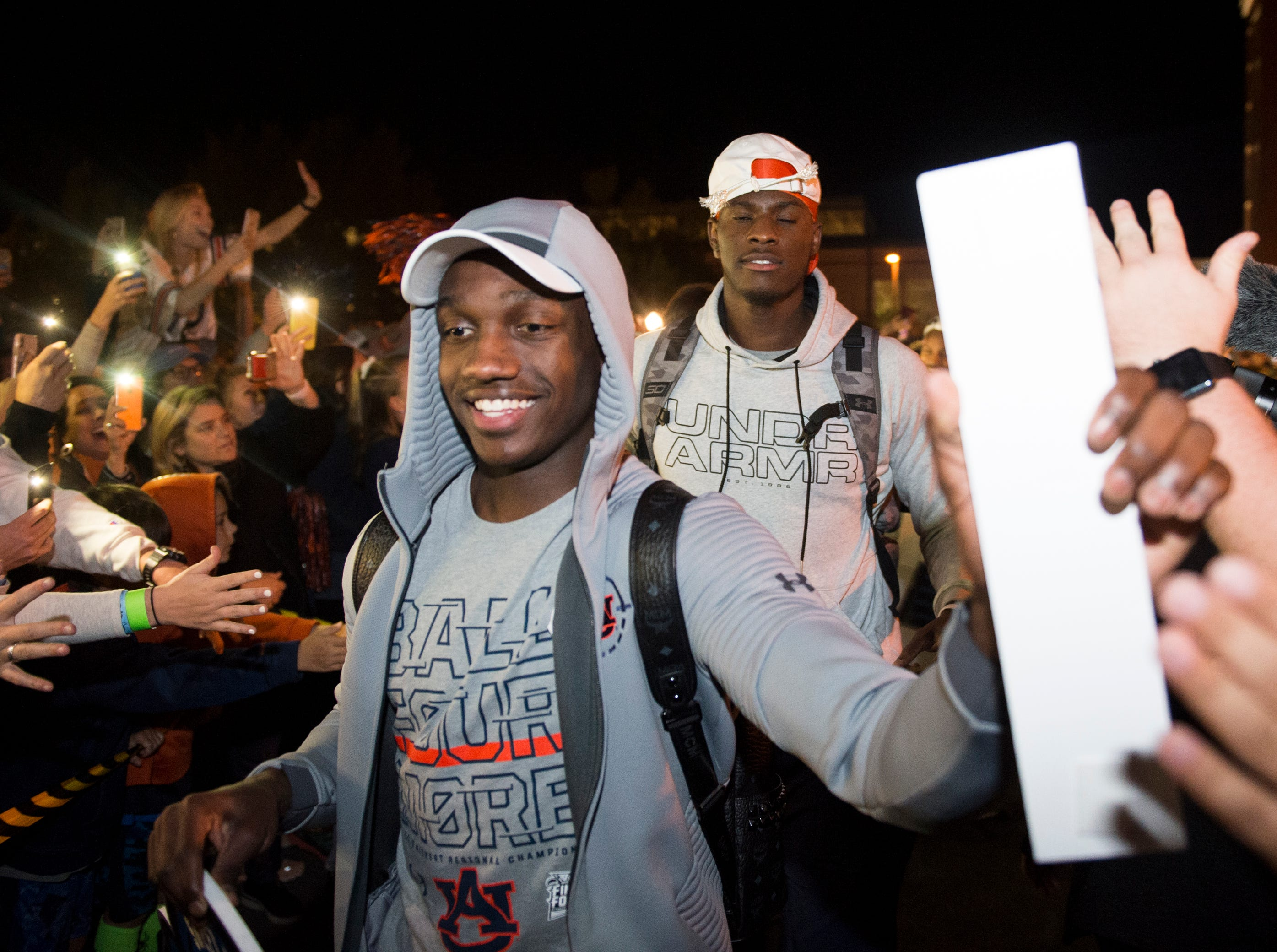 Auburn guard Jared Harper (1) greets fans as they  welcome back the Auburn basketball team after the team's Elite Eight win outside Auburn Arena in Auburn, Ala., on Sunday, March 31, 2019.