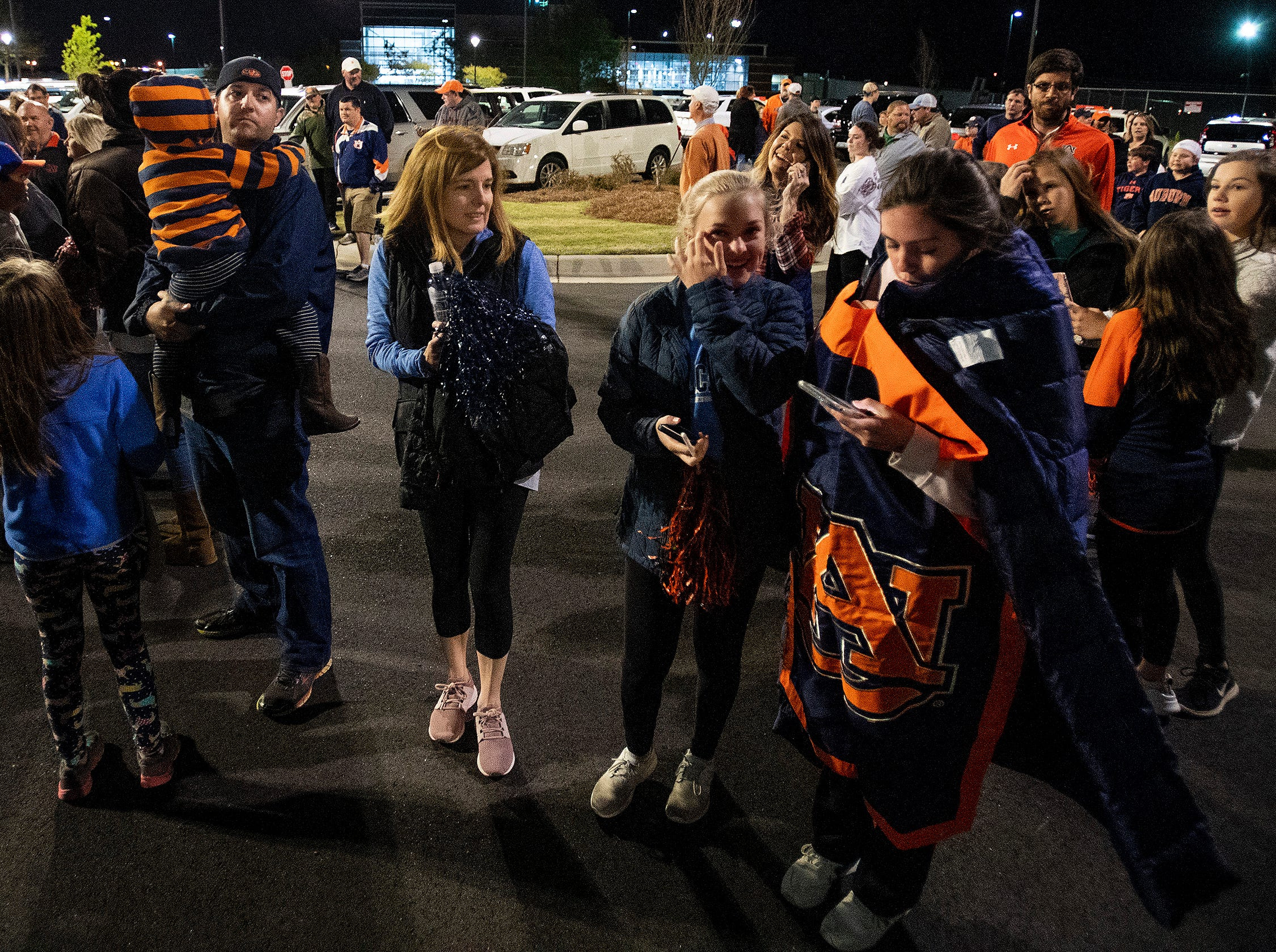 Auburn fans wait for the Auburn men's basketball team to arrive at the Montgomery, Ala., airport on Sunday evening March 31, 2019 after defeating Kentucky in Kansas City to advance to the NCAA Basketball Final Four next weekend.