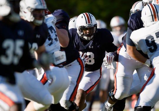 Auburn running back JaTarvious Whitlow runs during drills during practice in Auburn, Ala.