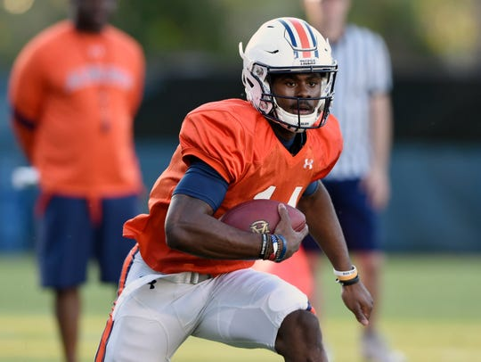 Malik Willis runs during practice on Wednesday, March 27, 2019 in Auburn, Ala.