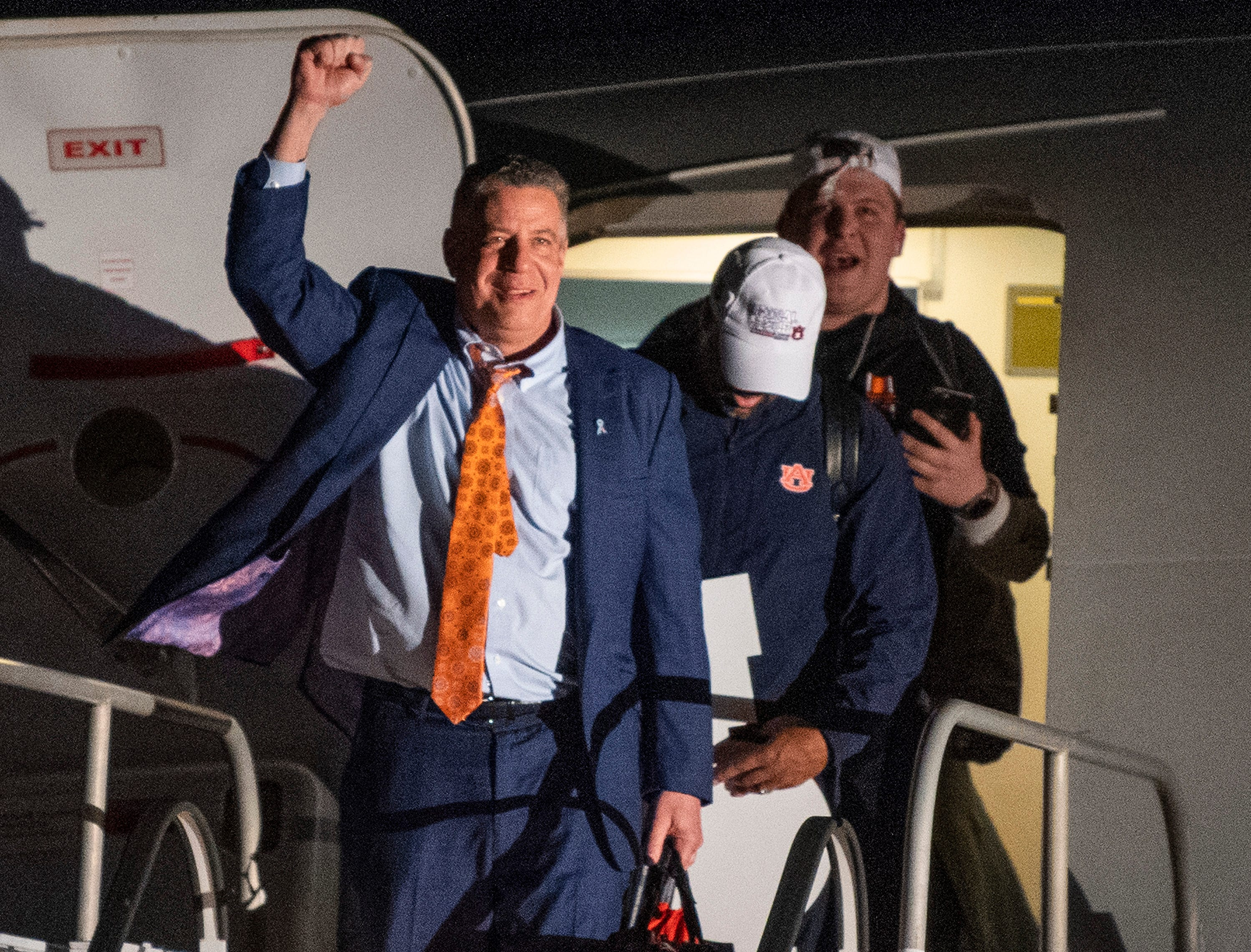 Head coach Bruce Pearl pumps his fist as the Auburn men's basketball team arrives at the Montgomery, Ala., airport on Sunday evening March 31, 2019 after defeating Kentucky in Kansas City to advance to the NCAA Basketball Final Four next weekend.