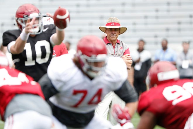 Alabama head coach Nick Saban watches as redshirt sophomore quarterback Mac Kones fields a snap with the first-team offense during Saturday's spring scrimmage March 30, 2019 inside Bryant-Denny Stadium in Tuscaloosa. (Photo by Kent Gidley/Alabama athletics)