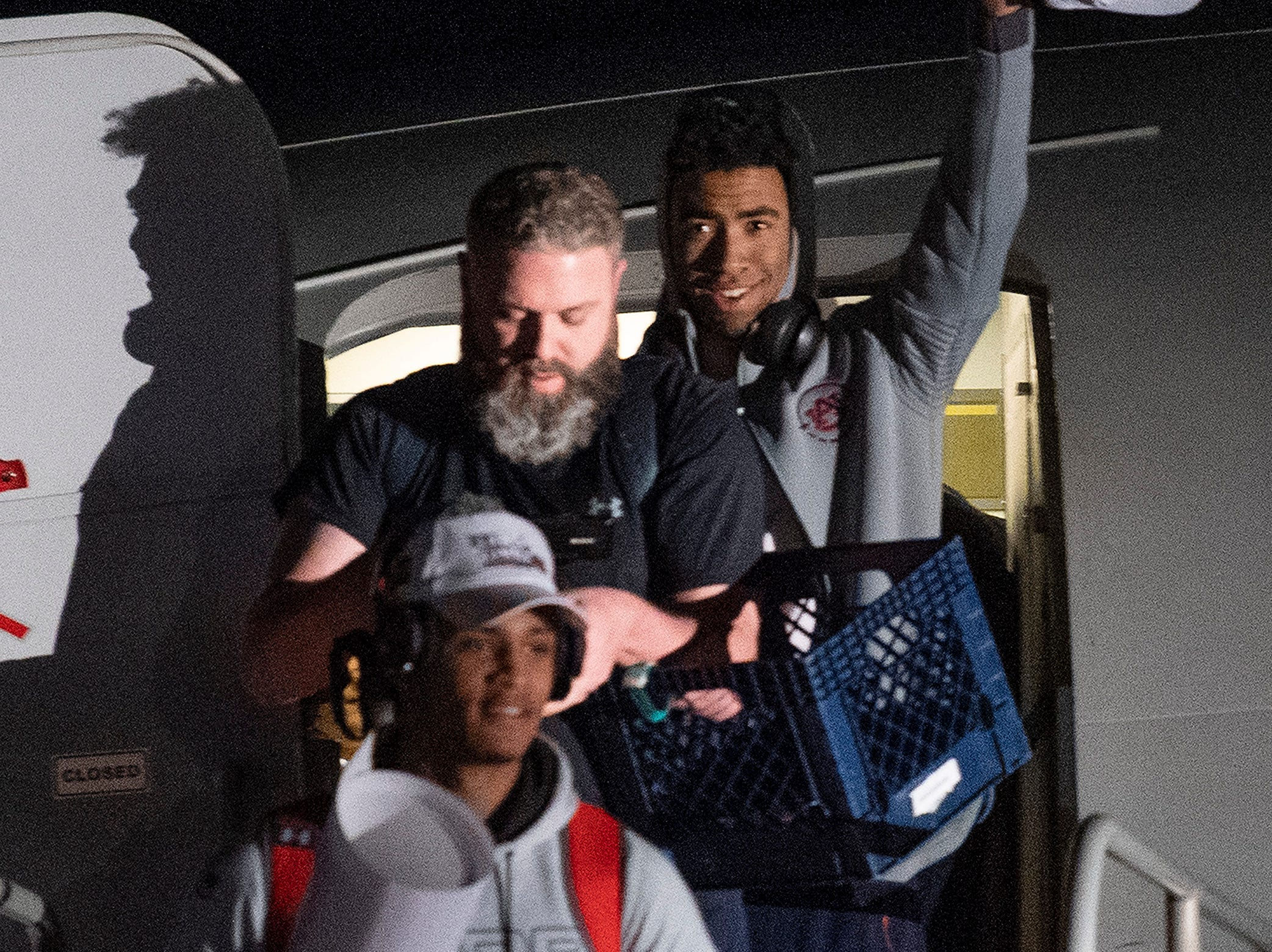 Players wave as the Auburn men's basketball team arrives at the Montgomery, Ala., airport on Sunday evening March 31, 2019 after defeating Kentucky in Kansas City to advance to the NCAA Basketball Final Four next weekend.