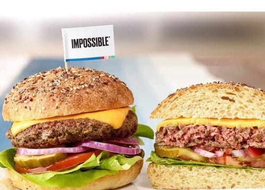 The Impossible Burger at Juicy's Wellness Cafe is made with potato starch, but it's so realistic, it 'bleeds' pink when on the griddle.