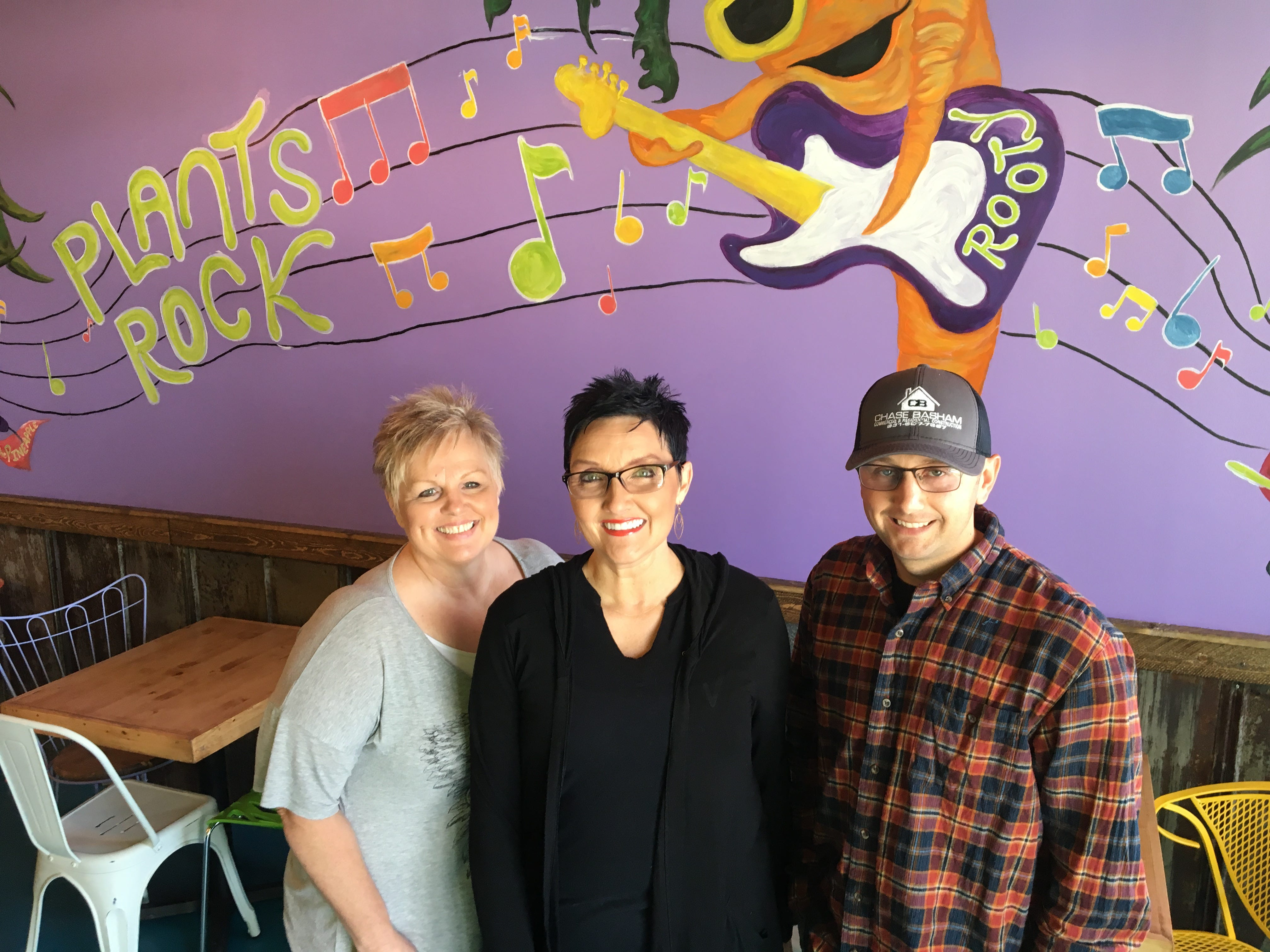Juicy's Wellness Cafe partners Mary Beth Laxson, center, and Chase Basham, right, stand with manager Rebecca Warner in the soon-to-be-opened Murfreesboro location.