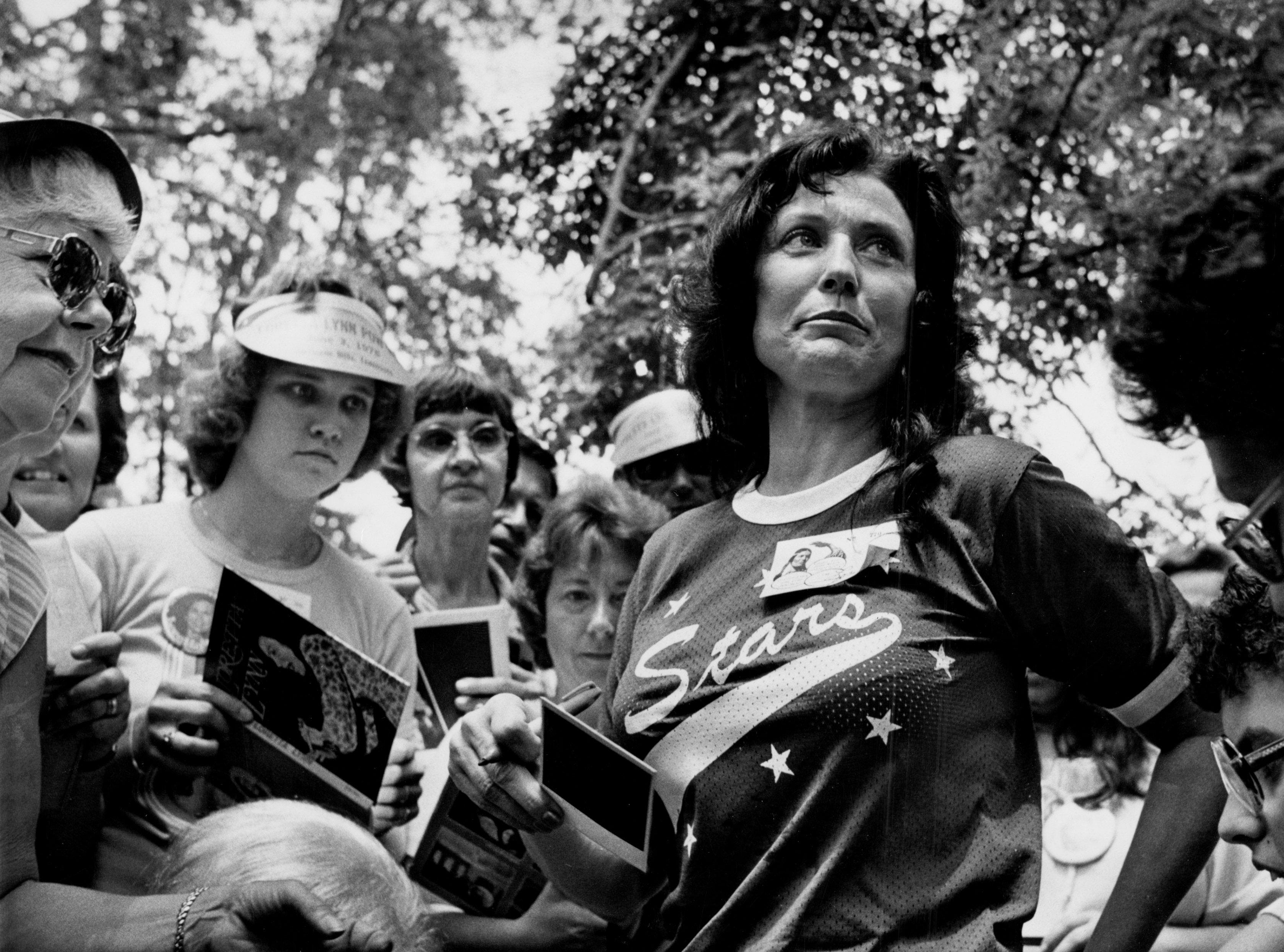 Many of Loretta Lynn's fans got a head start on the week's Fan Fair activities at a special catfish fry at the star's home in Hurricane Mills, Tenn. June 4, 1978. Lynn, center, signed autographs for nearly four hours.