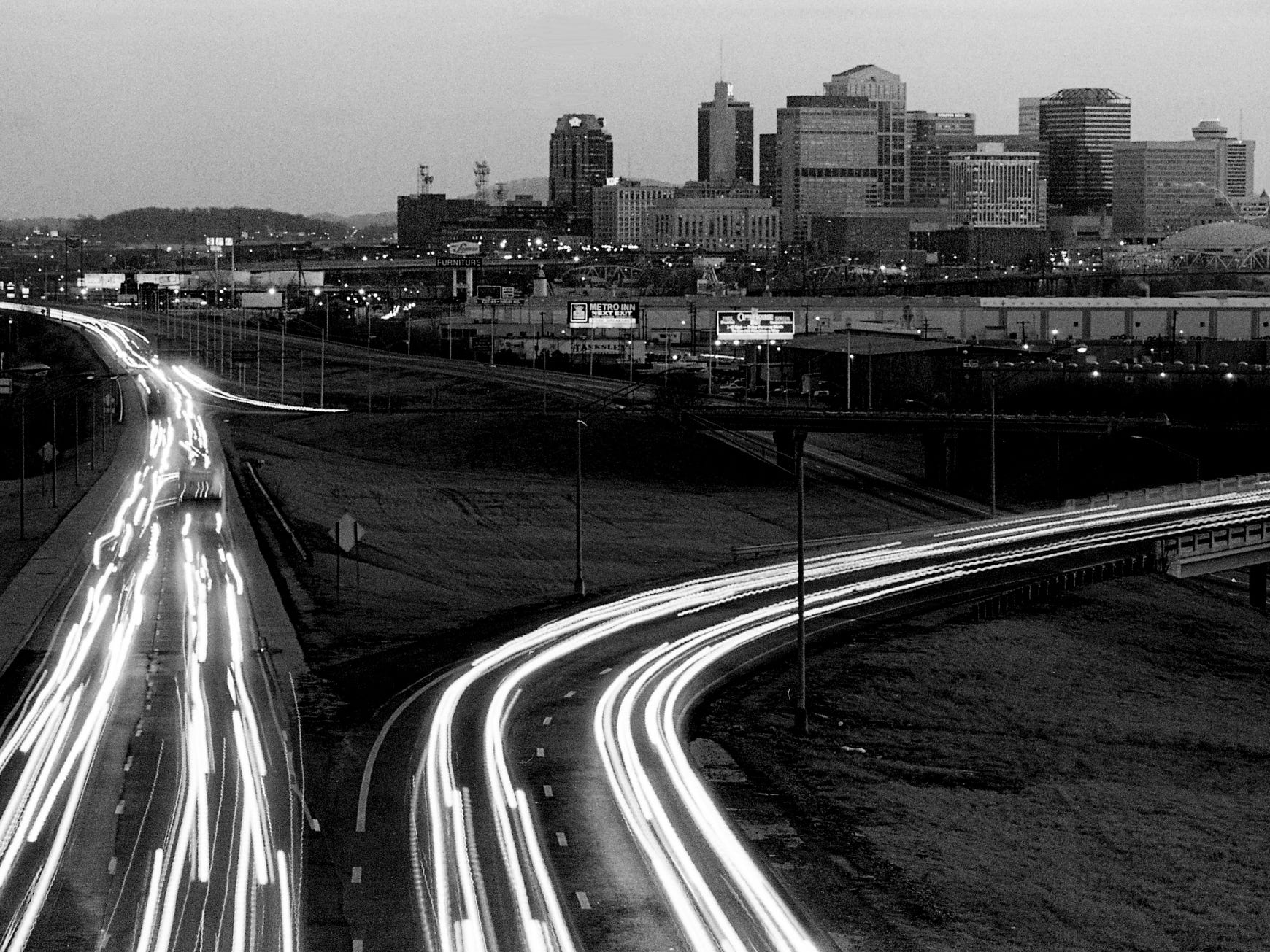 A time exposure causes headlights to streak around the junction of Interstate 65 and I-265 north of downtown Nashville Jan. 20, 1989 as some Midstate road projects for the year will help the growing volume of traffic on the roads.