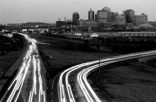 A time exposure causes headlights to streak around the junction of Interstate 65 and I-265 north of downtown Nashville Jan. 20, 1989 in this file photo.