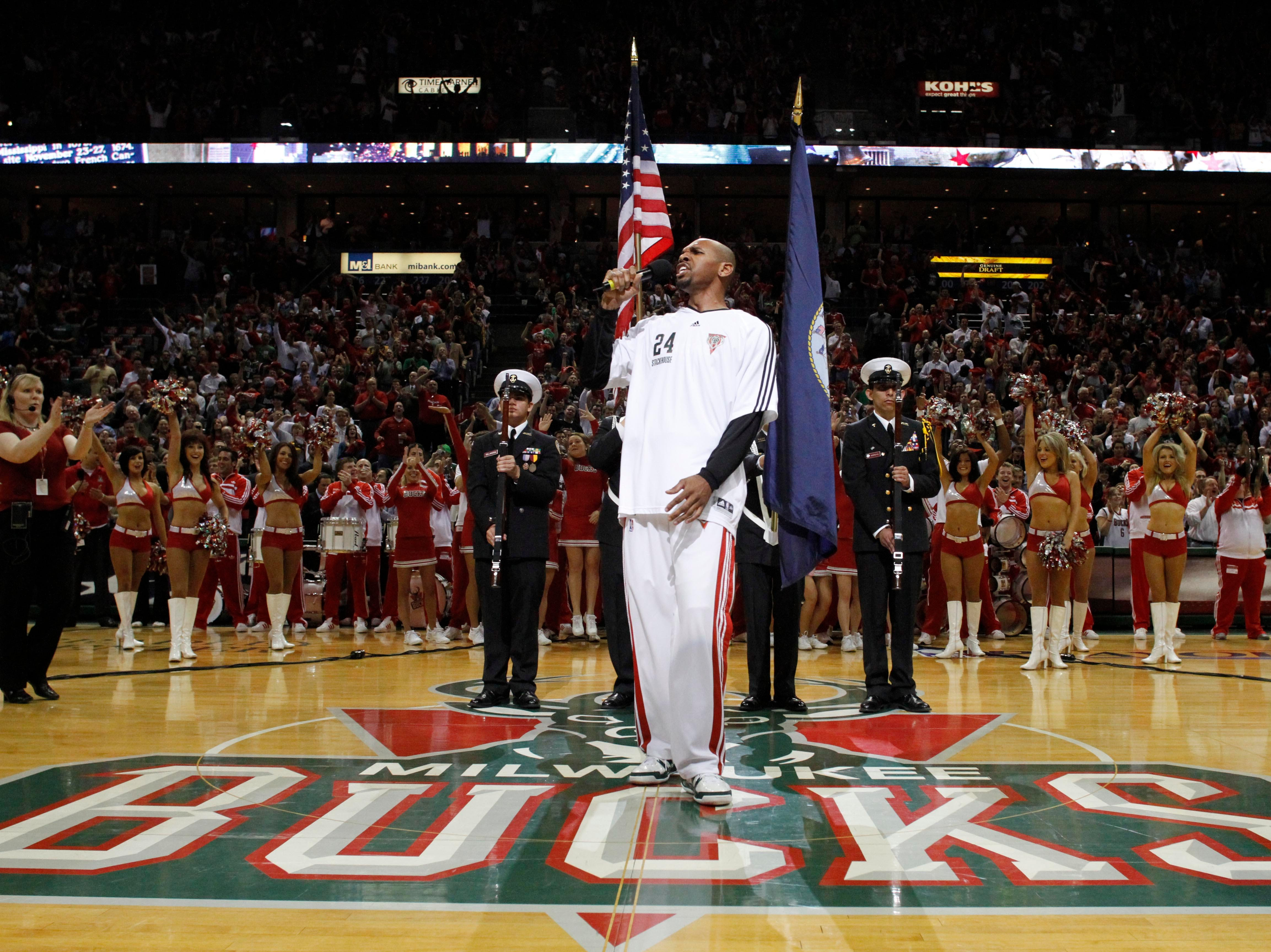 Milwaukee Bucks' Jerry Stackhouse, foreground, sings the national anthem at the start of Game 6 of a first-round basketball playoff series against the Atlanta Hawks on Friday, April 30, 2010, in Milwaukee.