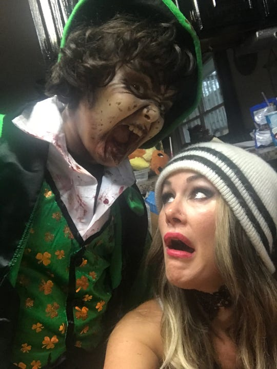"""Stacey Dixon, right, did the makeup for her then 9-year-old son, Phoenix, to promote the 2017 screening of horror comedy film """"Leprechaun"""" at Full Moon Cineplex in Hermitage, owned by Dixon and her husband, Ben."""