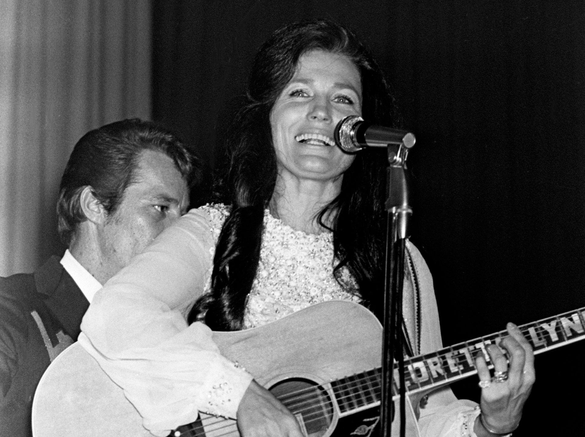 """More than 1,500 inmates at Tennessee State Prison in Nashville applaud, whistle and yell for """"more"""" from singer Loretta Lynn on Dec. 23, 1970. The Kentucky coal miner's daughter said she enjoyed doing the show for those who are behind bars because Christmas is so bleak for most of them."""