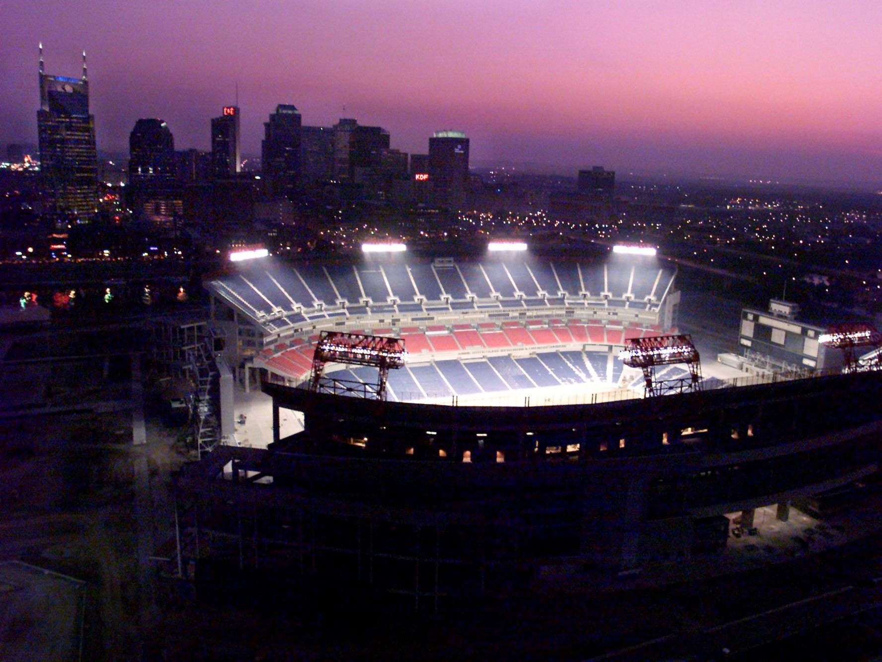 With the skyline of Nashville in the background, the new stadium's lights are on for next 100 hours for the first time May 14, 1999.