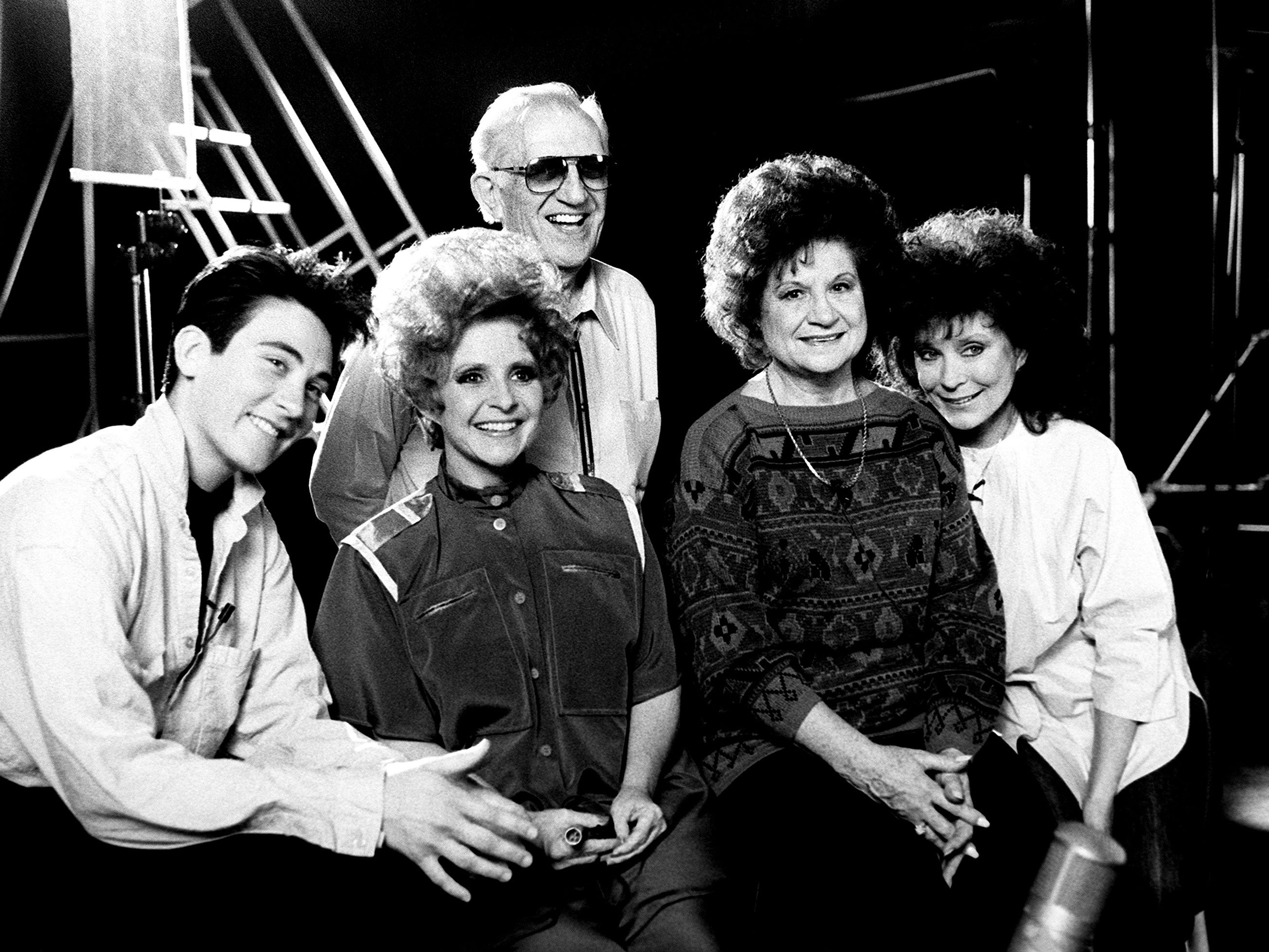 Canadian country star K.D. Lang, left, pose with legendary vocalists Brenda Lee, Kitty Wells, Loretta Lynn and producer Owen Bradley, in back, April 4, 1988. The four singers got together in Bradley's recording studio to make a music video of a medley they recorded for Lang's next album.