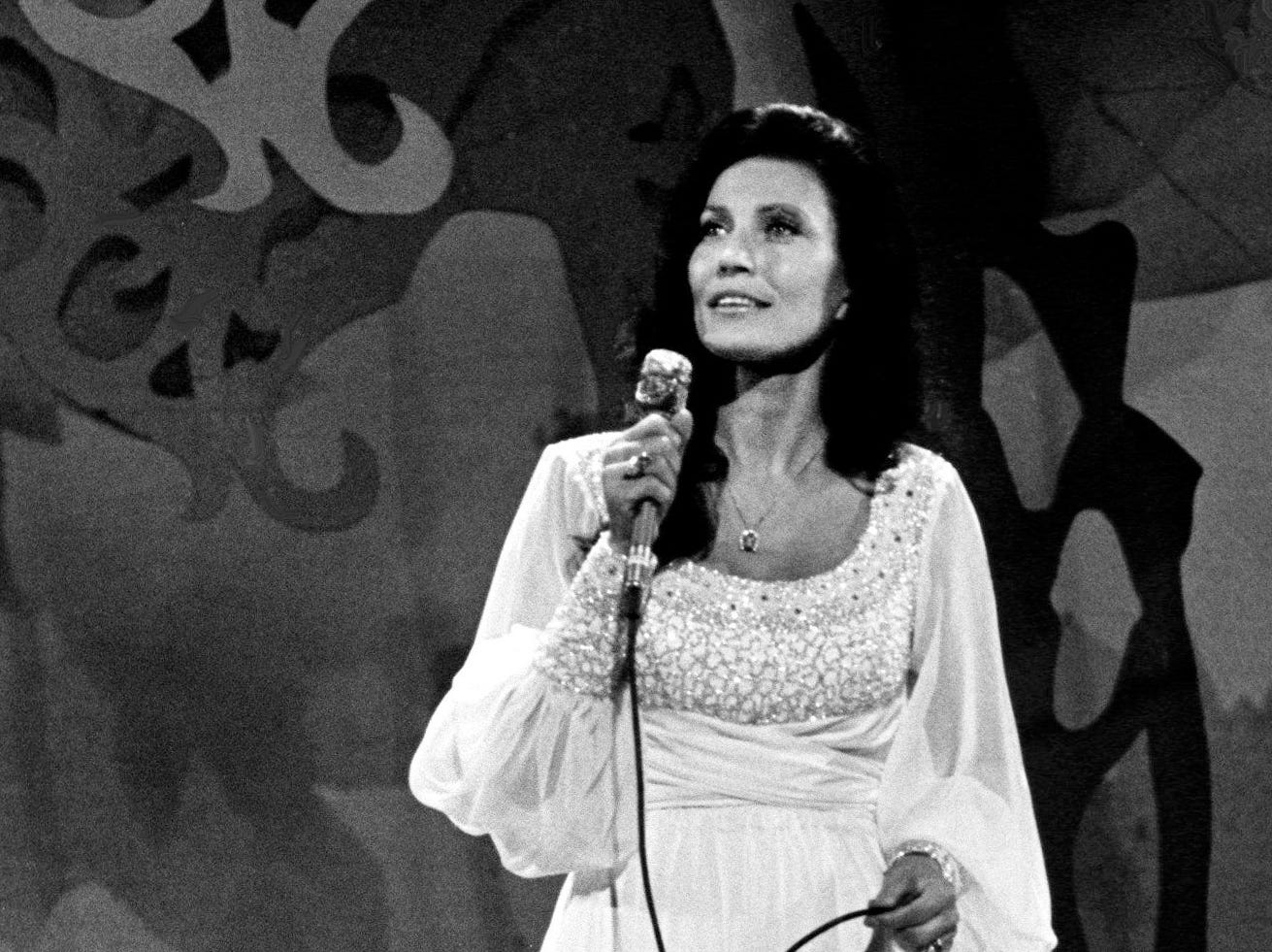 Loretta Lynn is performing for the packed crowd at the nationally televised CMA Awards show at the Grand Ole Opry House Oct. 13, 1975.