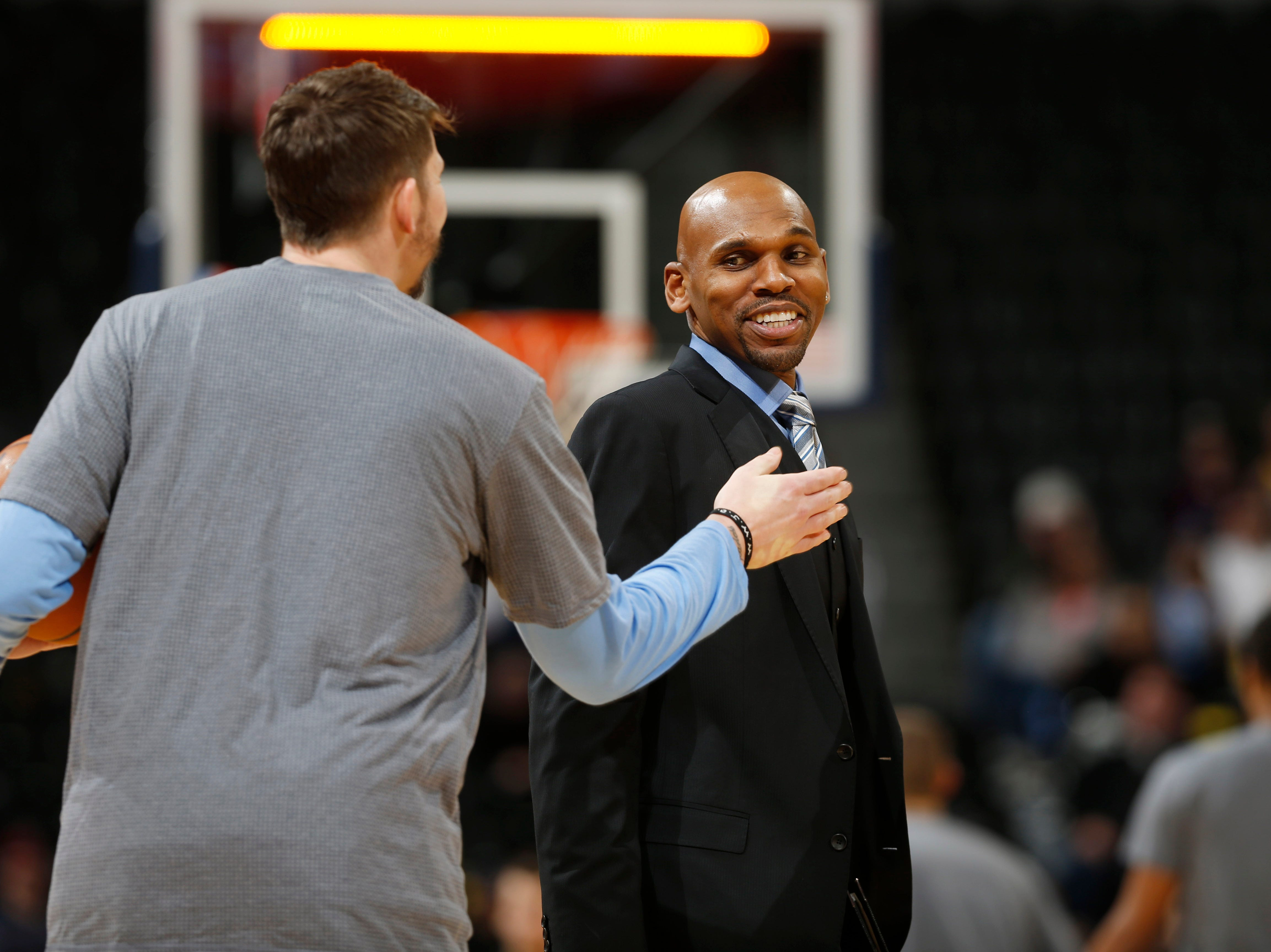 Denver Nuggets guard Mike Miller (3), front, talks with Toronto Raptors assistant coach Jerry Stackhouse in the second half of an NBA basketball game Monday, Feb. 1, 2016, in Denver. The Nuggets won 112-93.