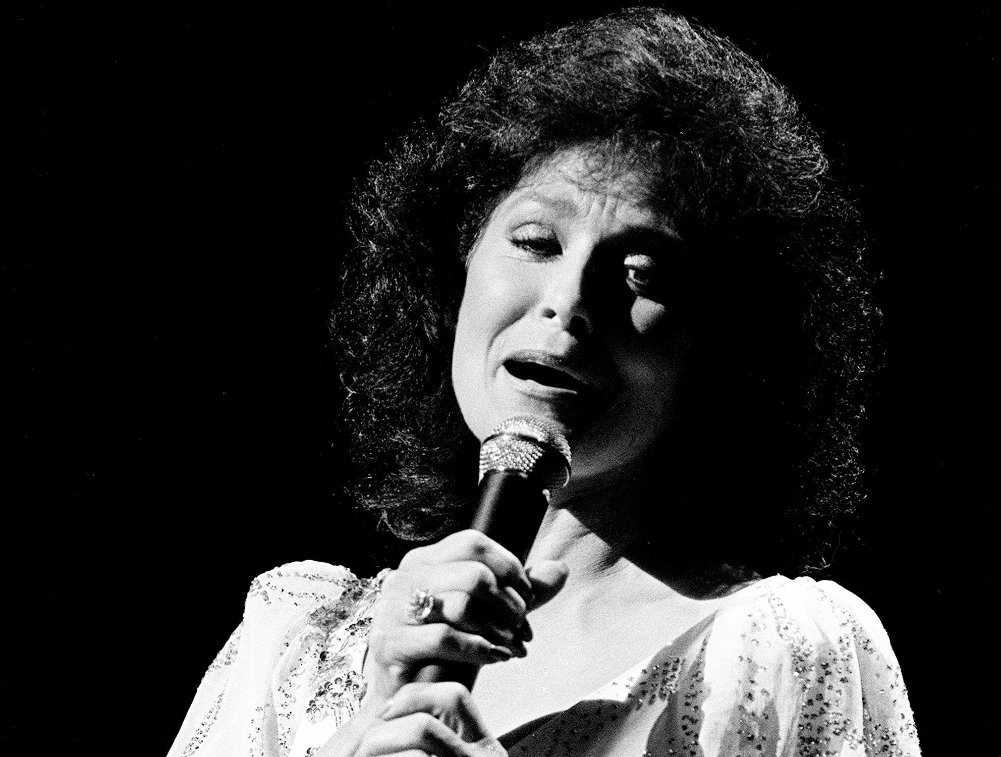 """Loretta Lynn sings """"Walkin' the Floor Over You"""" in a tribute to the late Hall of Famer Ernest Tubb during the CMA Awards show at the Grand Ole Opry House Oct. 8, 1984."""