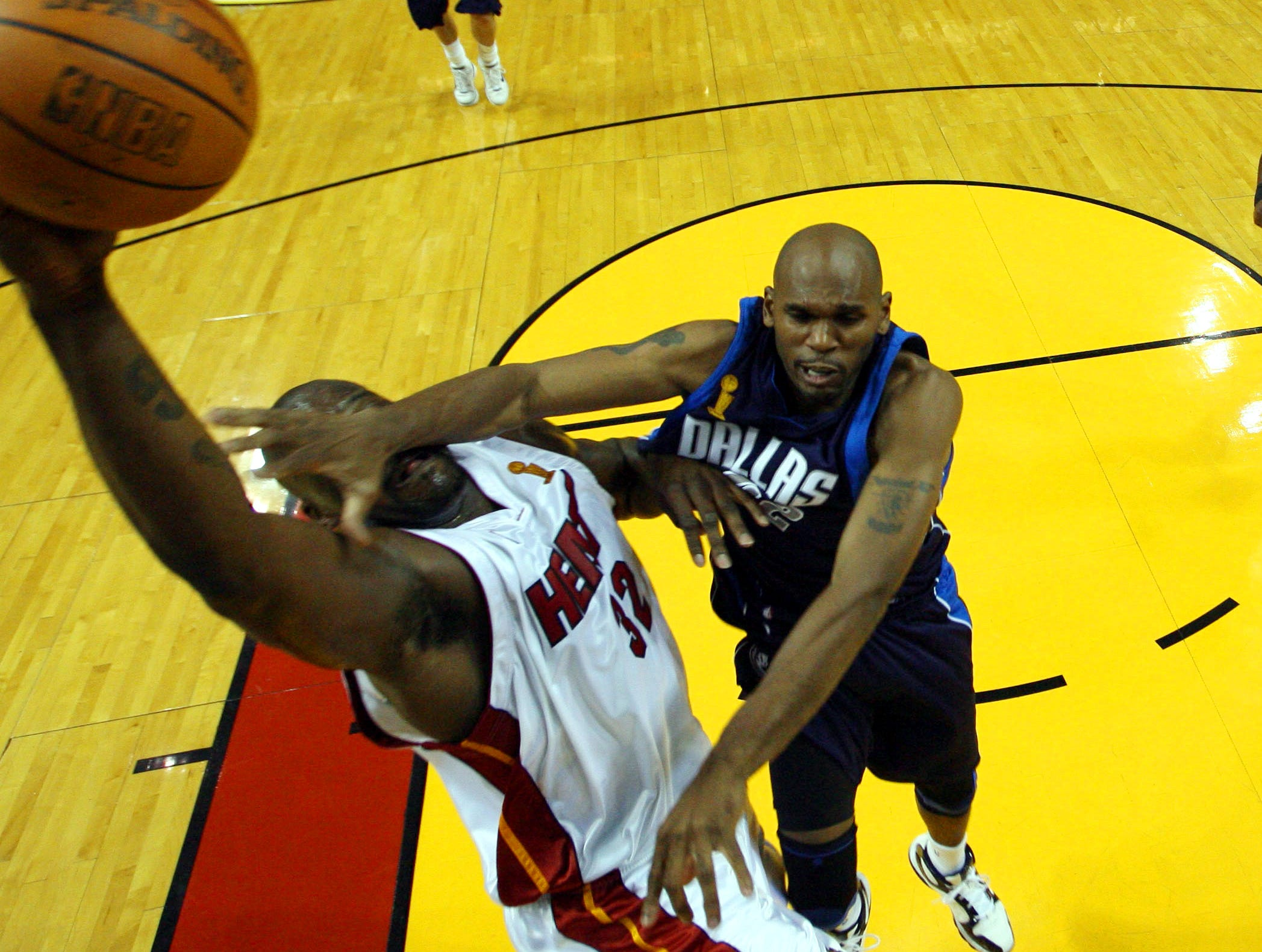 Miami Heat center Shaquille O'Neal (32) is defended by Dallas Mavericks guard Jerry Stackhouse, right, in the second half of Game 4 during the NBA basketball finals in Miami, Thursday, June 15, 2006.  The Heat won, 98-74.