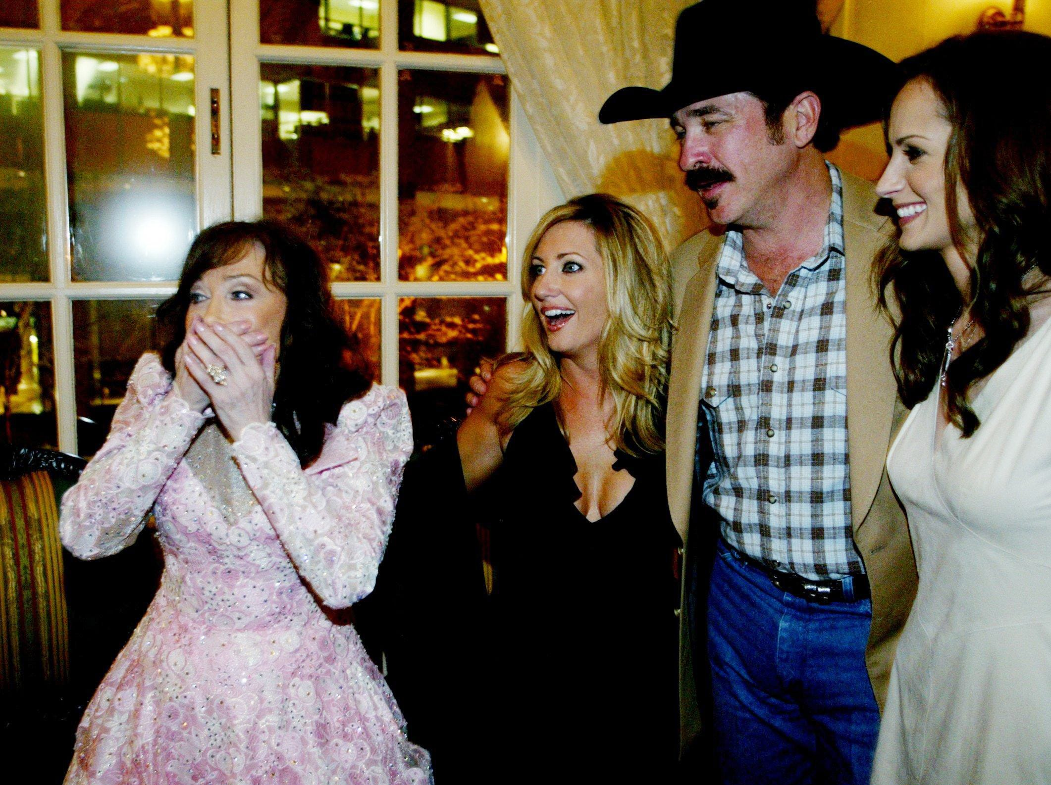 """Lynn, left, is joking with Lee Ann Womack, Kix Brooks and Chely Wright during her new album release party at the Hermitage Hotel April 22, 2004. White Stripes member Jack White was producer of Lynn's """"Van Lear Rose"""" album."""
