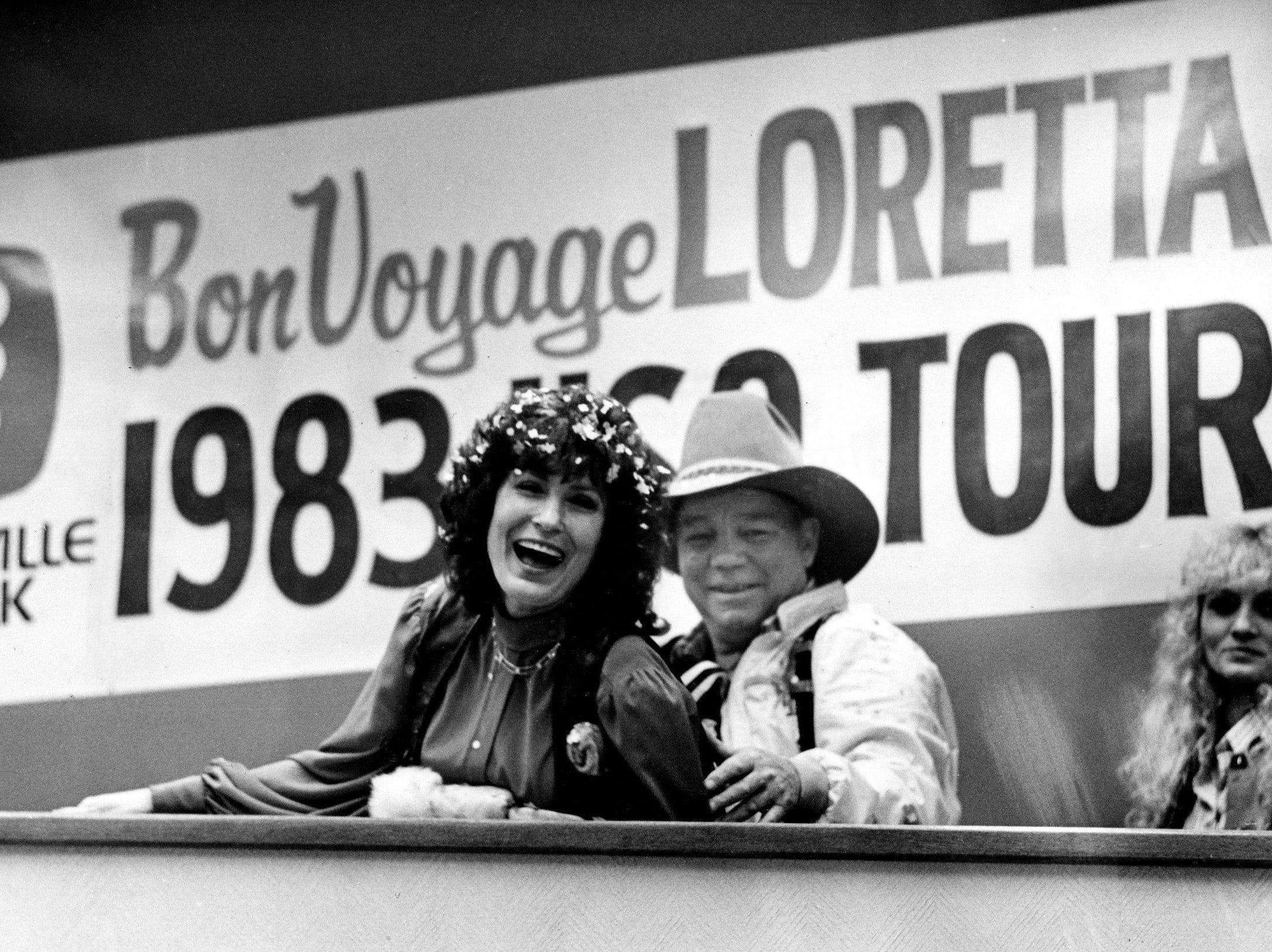 """Loretta Lynn, left, and her husband, Mooney, are on the ramp to board their flight at Metro Airport for West Germany Nov. 15, 1983. The star will do a holiday special, """"Loretta Lynn's Christmas Card,"""" which will chronicle her USO sponsored tour through West Germany"""