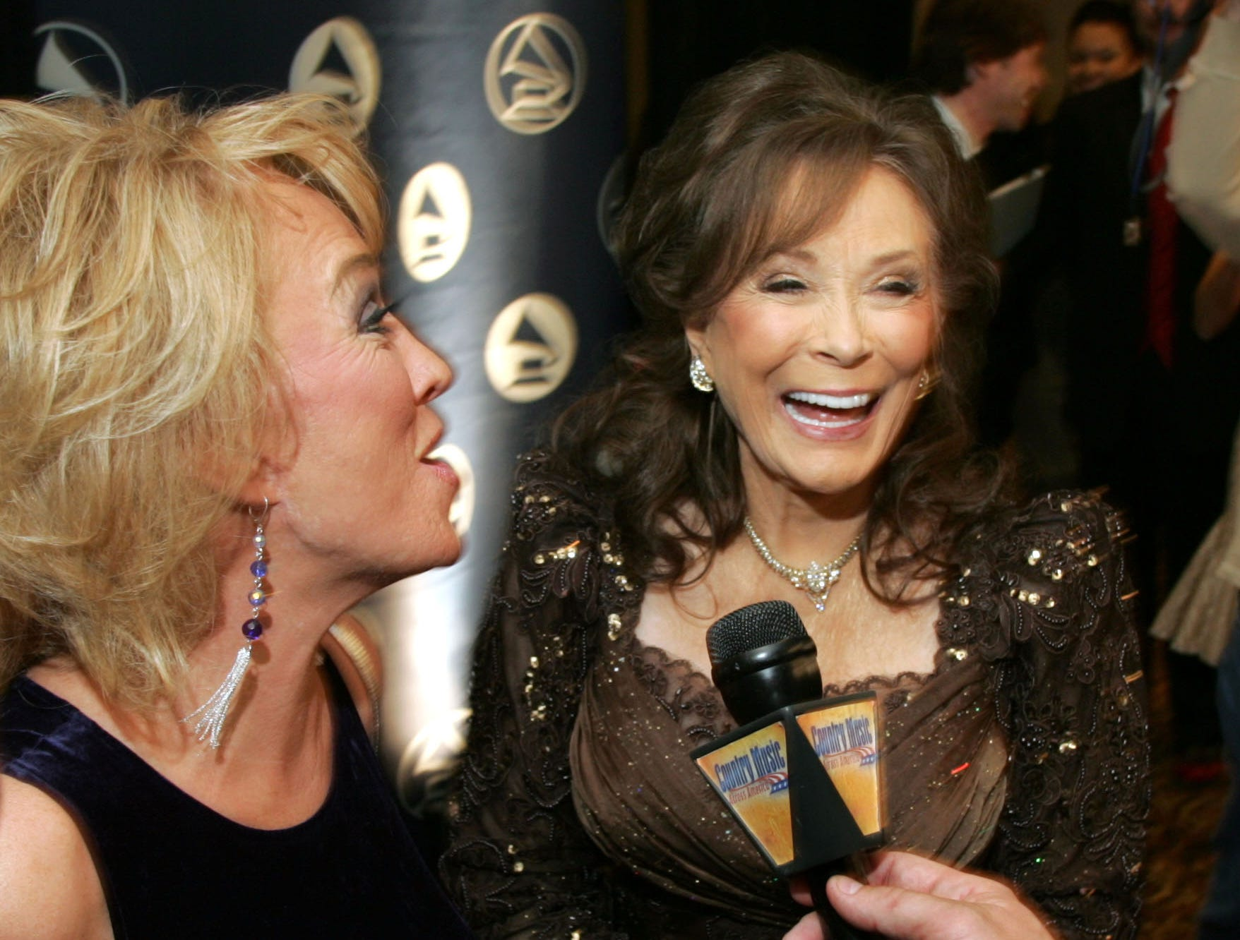 Loretta Lynn, right, and Tanya Tucker share a laugh during an interview with reporters before the 2007 Recording Academy Honors at the Loews Vanderbilt Plaza Hotel in Nashville April 9, 2007.