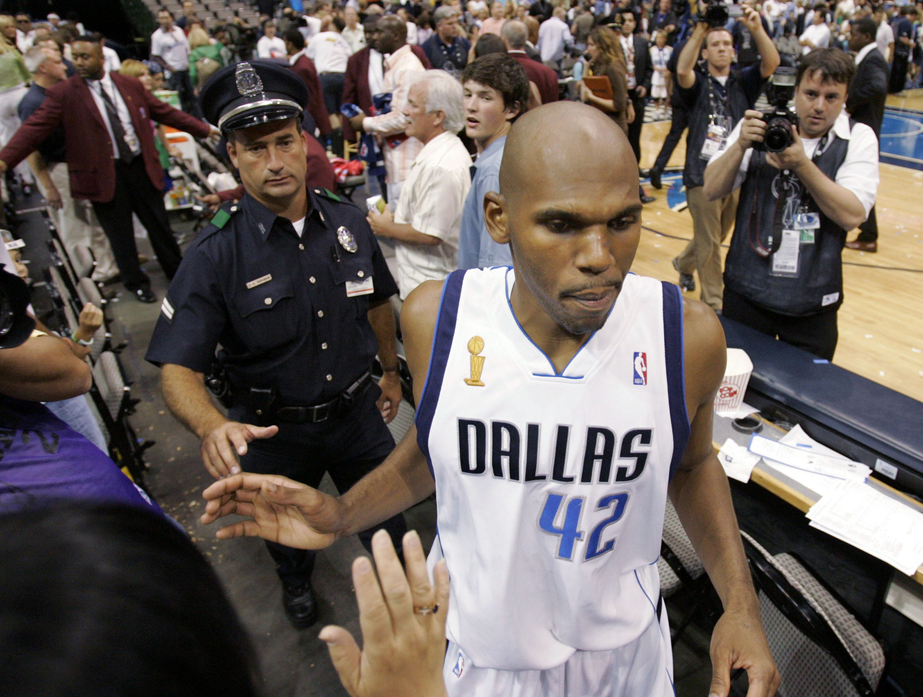 Dallas Mavericks' Jerry Stackhouse slaps hands with fans as he leaves the court after the Mavericks beat the Miami Heat 99-85 in Game 2 of the NBA basketball finals in Dallas, Sunday, June 11, 2006. Stackhouse scored 19 points in the game.