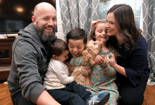 """Matthew Paul Turner with his wife, Jessica; children, Elias, 10, Ezra, 4, and Adeline, 7; and their dog, Zelda. Turner says his kids helped inspire him to write children's books. """"I wanted to teach my kids a beautiful story about God and God's delight in who they are,"""" he said."""