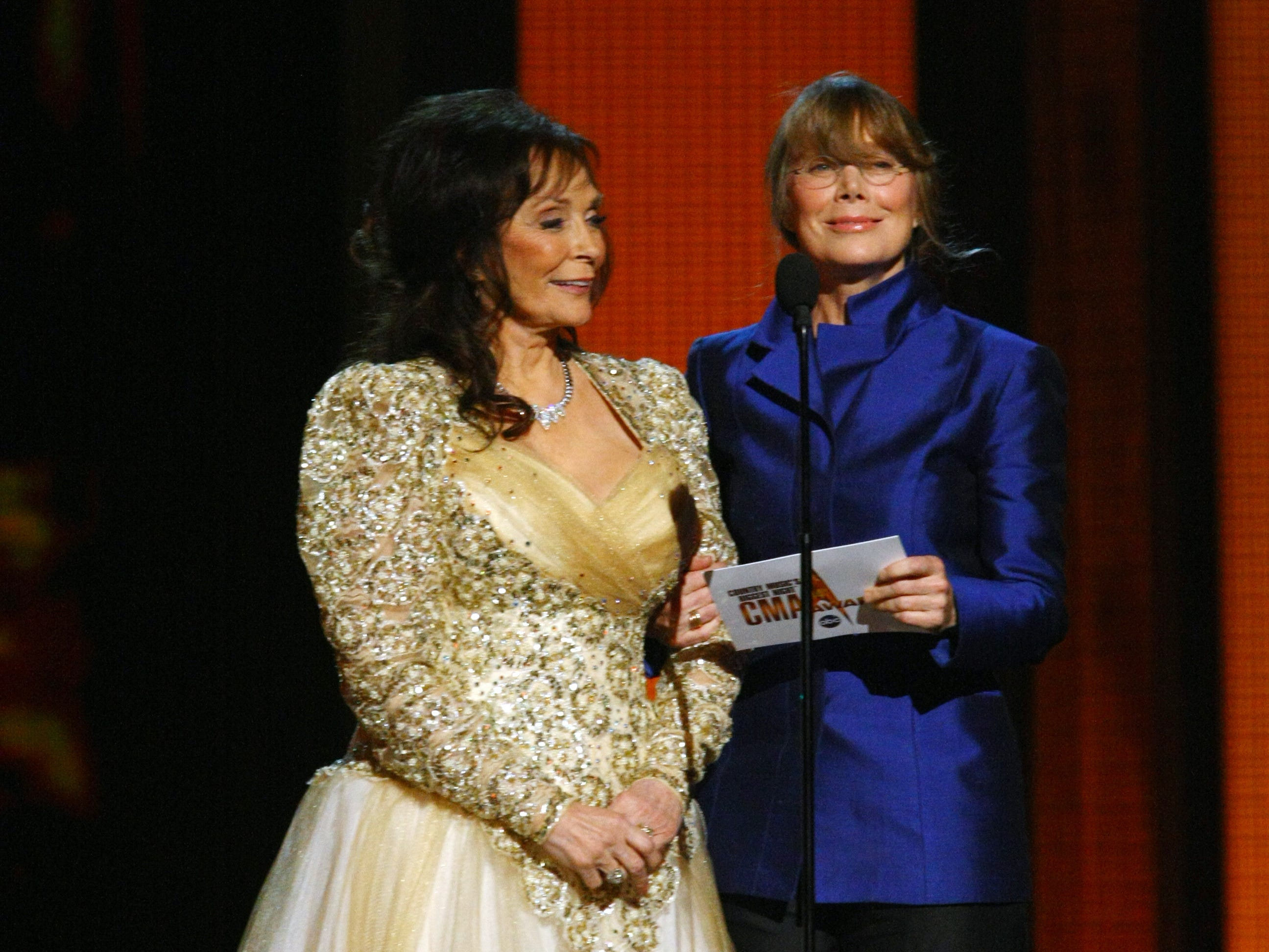 Loretta Lynn, left, and Sissy Spacek announce the winner for Female Vocalist of the Year at the 44th annual CMA Awards show Nov. 10, 2010, at the Bridgestone Arena.