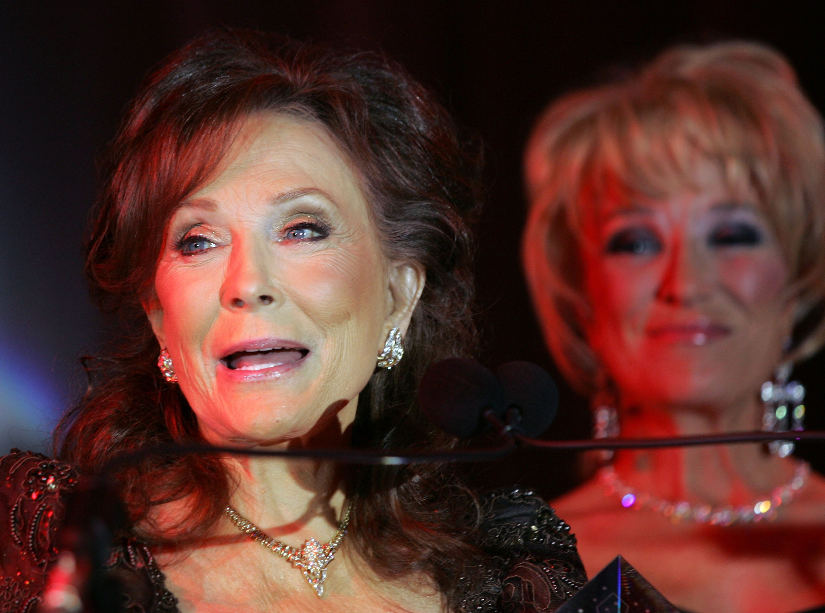 Loretta Lynn, left, receives an award at the 2007 Recording Academy Honors at the Loews Vanderbilt Plaza Hotel April 9, 2007. Tanya Tucker, right presented the award for Lifetime Achievement.