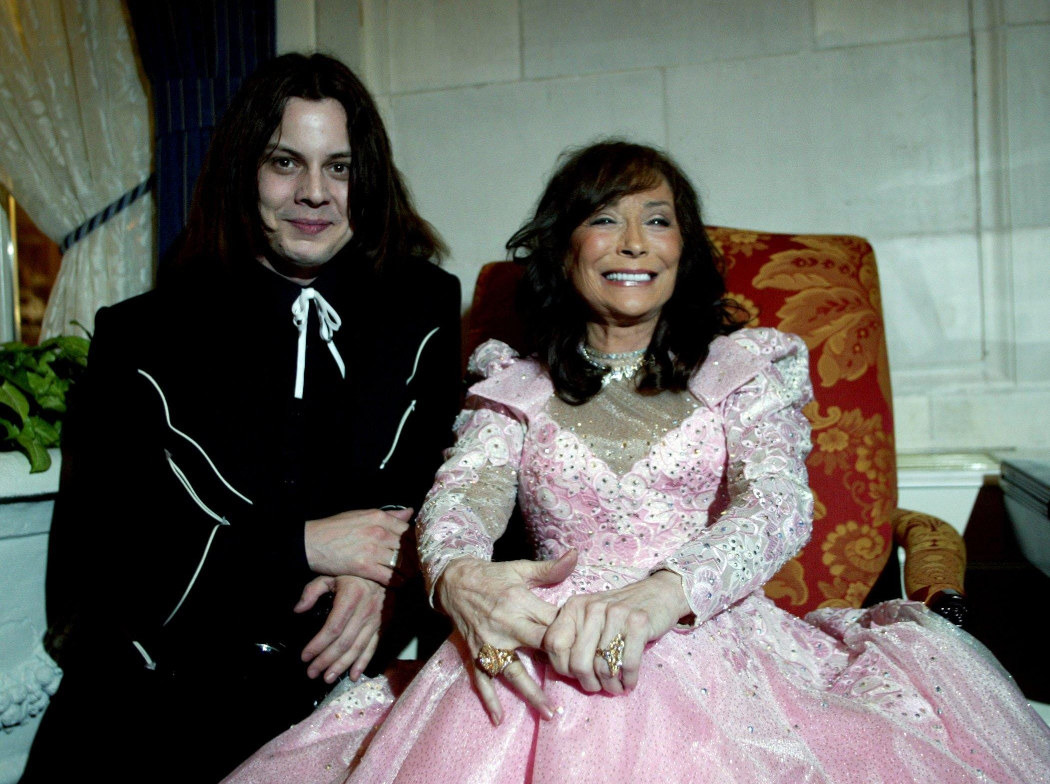 """Loretta Lynn, right, takes a break with White Stripes member Jack White during her new album release party at the Hermitage Hotel April 22, 2004. White was producer of Lynn's """"Van Lear Rose"""" album."""