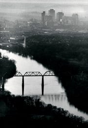 A dreary Nashville day Dec. 31, 1981 has some attractive aspects as this aerial photo shows the railroad bridge across the Cumberland River near Shelby Park sharply contrasted with the Nashville skyline.
