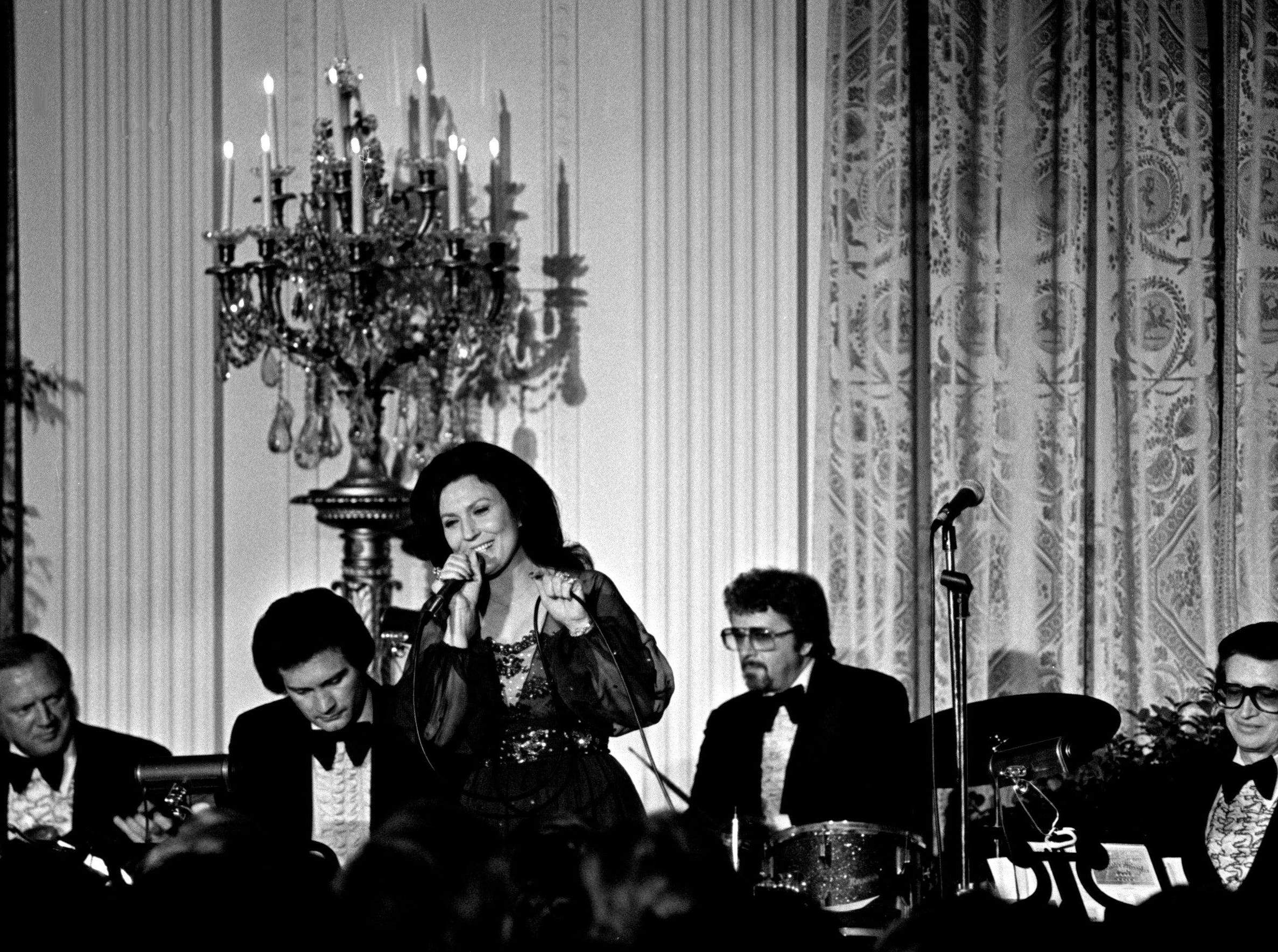 Loretta Lynn, center, is performing with a group of Nashville studio musicians in the East Room of the White House during country music night in Washington, D.C. April 17, 1978. More than 200 guests attended a gala reception give by President and Mrs. Jimmy Carter honoring the CMA.