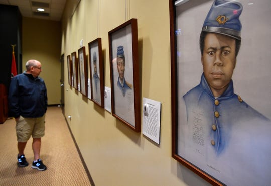 Marvin Mescher looks at a new exhibit  Saturday, March 30, 2019, at Fort Negley visitor center that features portraits of 17 African-American men who served as soldiers in the Civil War.