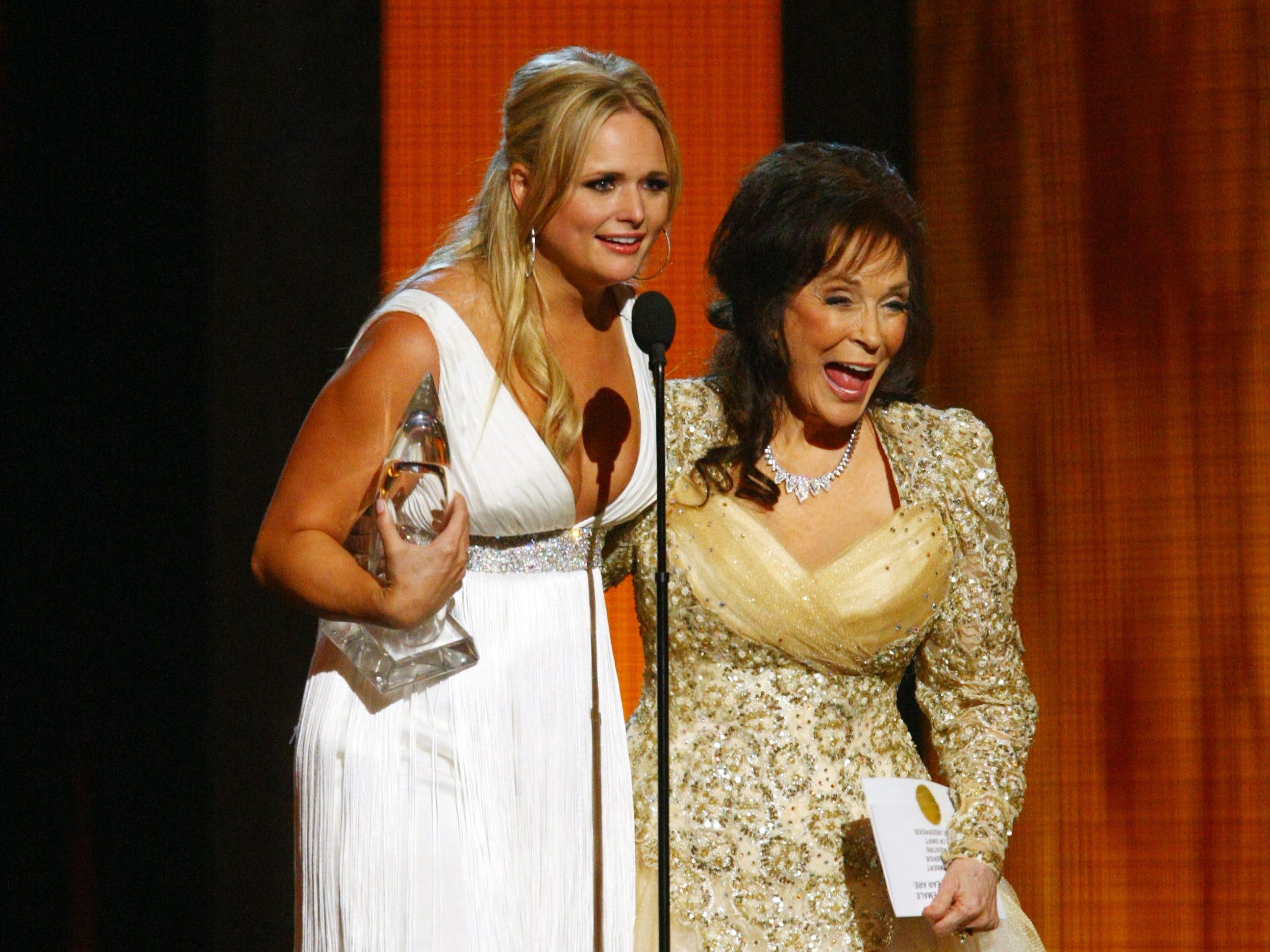 Miranda Lambert, left, accepts the award for Female Vocalist of the Year from Loretta Lynn at the 44th annual CMA Awards show Nov. 10th, 2010, at Bridgestone Arena.