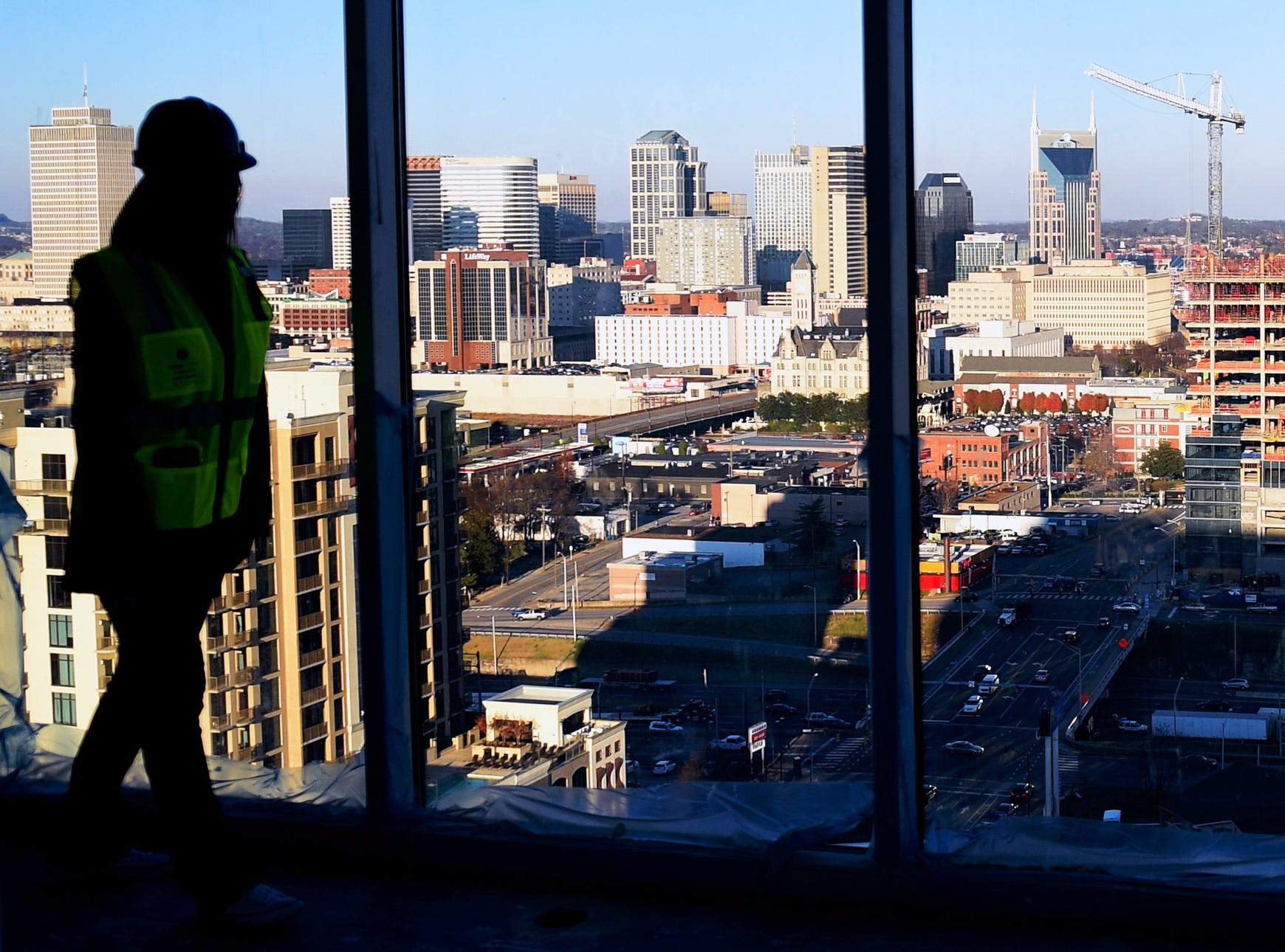Chloe Evans gives a tour of an penthouse under construction at Element Music Row high rise apartment building with views of downtown Nashville skyline on Dec. 20, 2015. Element Music Row, located on Demonbreun Street, will be completed in April 2016.