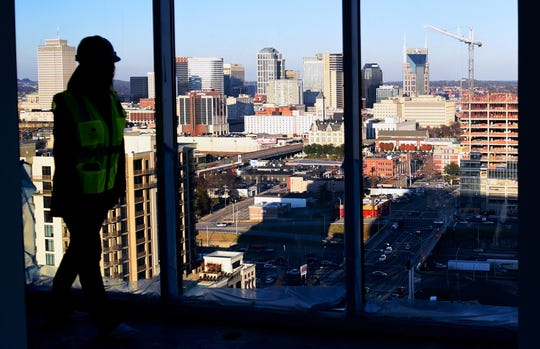 Chloe Evans gives a tour of a penthouse under construction at the Element Music Row high-rise apartment building Dec. 20, 2015.