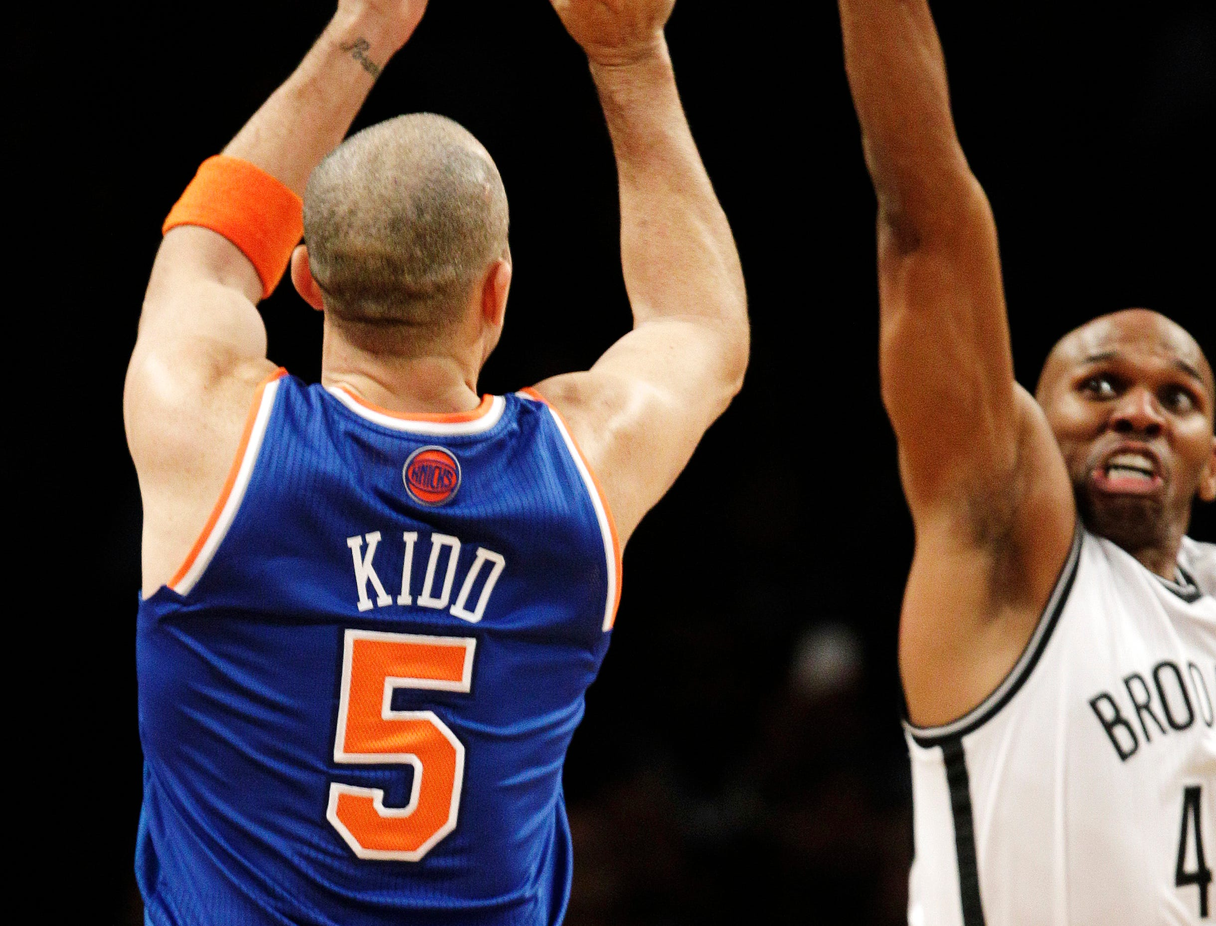 New York Knicks guard Jason Kidd (5) shoots a 3-pointer over Brooklyn Nets forward Jerry Stackhouse to lift the Knicks to a 100-97 win in their NBA basketball game at Barclays Center, Tuesday, Dec. 11, 2012, in New York.