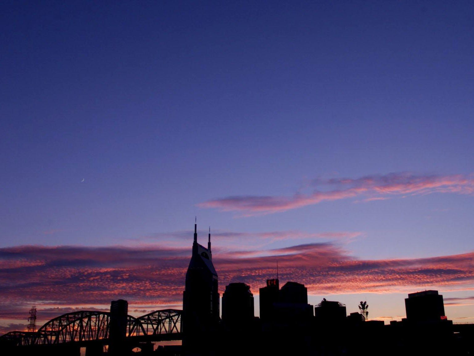 A view of downtown Nashville skyline at sunset Sept. 6, 2000 with Shelby Street footbridge at left.