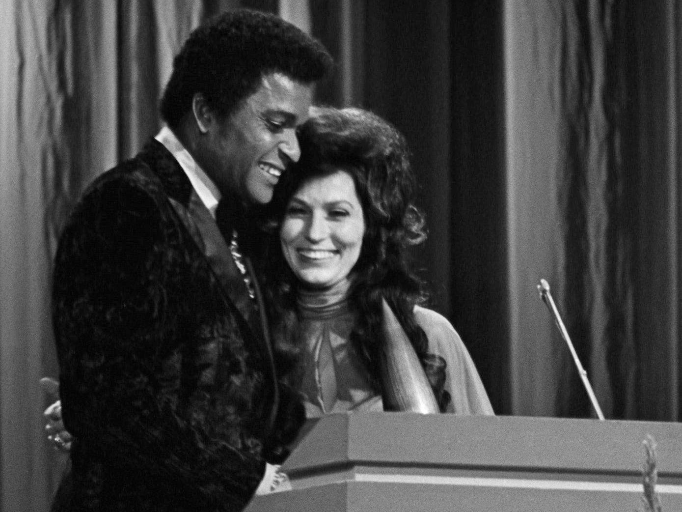 Loretta Lynn, right, accepts her award for the Female Vocalist of the Year from presenter Charley Pride during the annual CMA Awards show at the Grand Ole Opry House on Oct. 16, 1972.