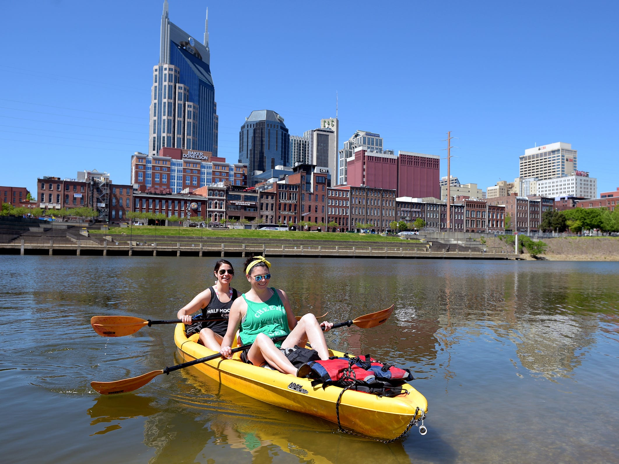 Erin Kette and Justine Auila take a canoe trip down the Cumberland River on April 17, 2016 in downtown Nashville.