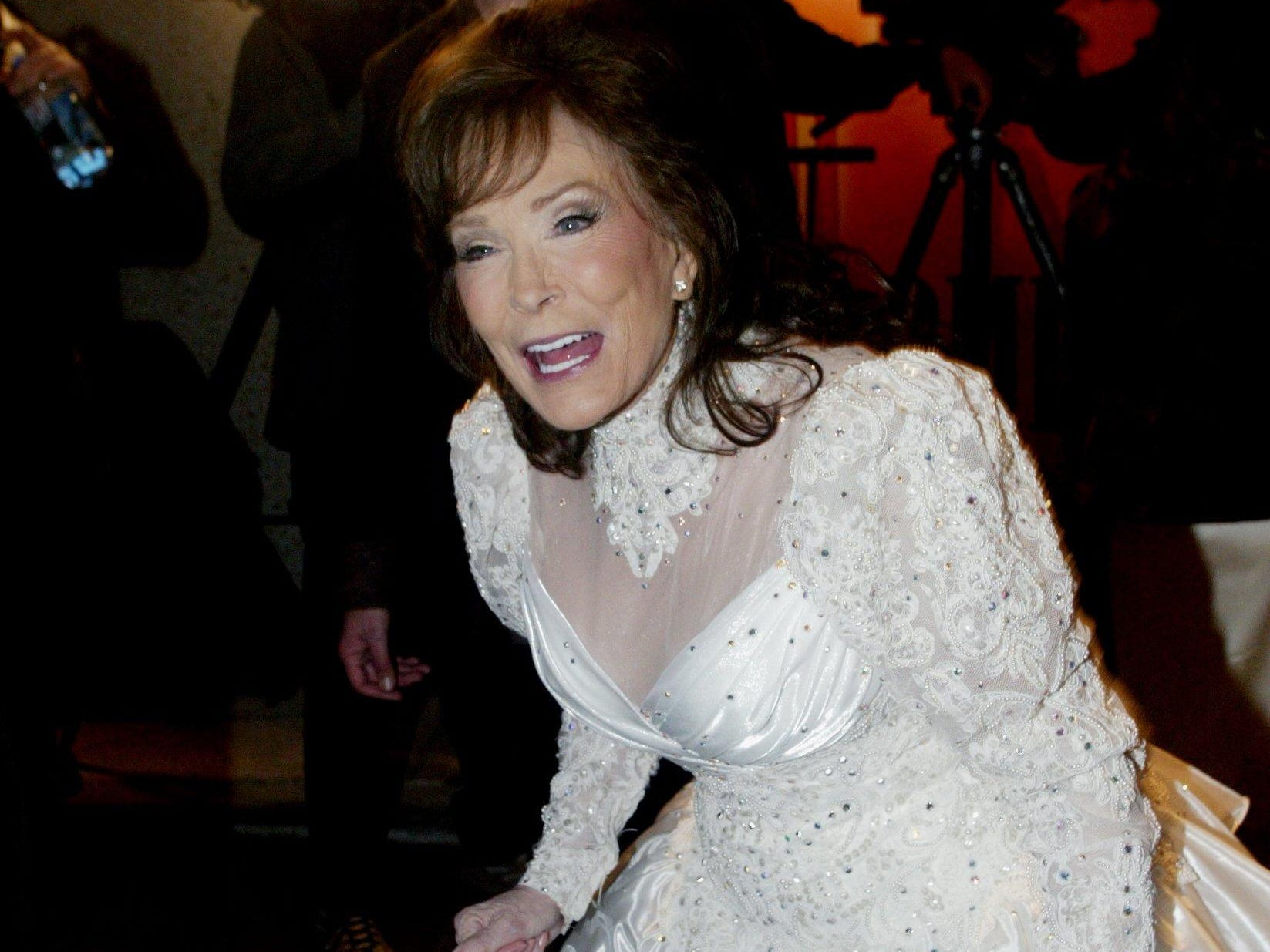 Loretta Lynn greets a friend at the 2004 BMI Country Awards dinner and show Nov. 8, 2004. Lynn was given a BMI ICON award during a tribute to the Country Music Hall of Famer.