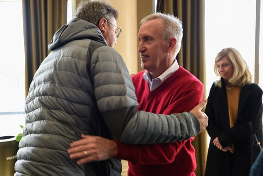 Belmont men's basketball coach Rick Byrd, right, hugs country music star Vince Gill during Byrd's retirement announcement Monday.
