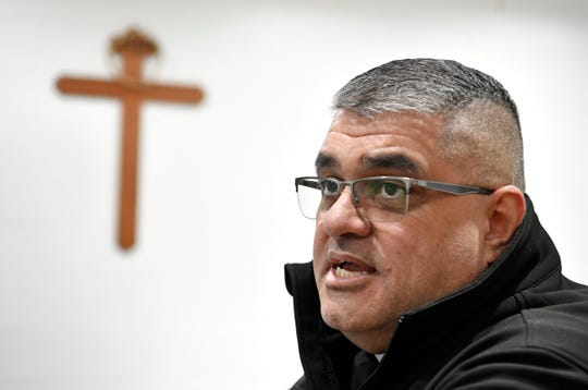 Dr. Eduardo F. Rocha speaks in the chapel of Riverbend Maximum Security Institution on March 31.
