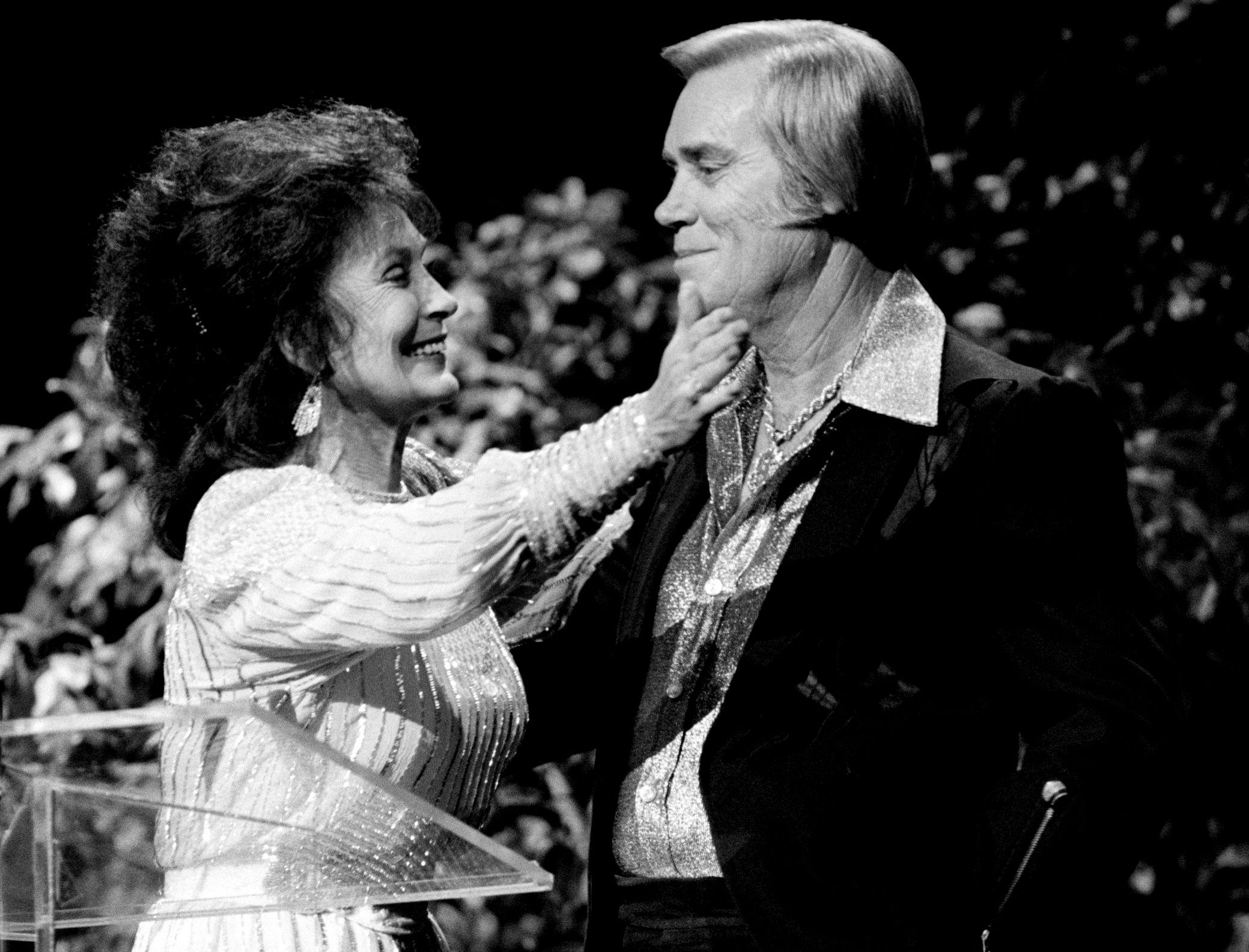 Presenter Loretta Lynn, left, introduces George Jones warmly as he receives the Music City News Living Legend Award during the awards show at the Grand Ole Opry House June 8, 1987.