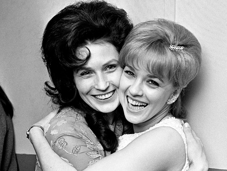 Loretta Lynn, left, and Connie Smith hug backstage at the Ryman Auditorium on Oct. 21, 1966.