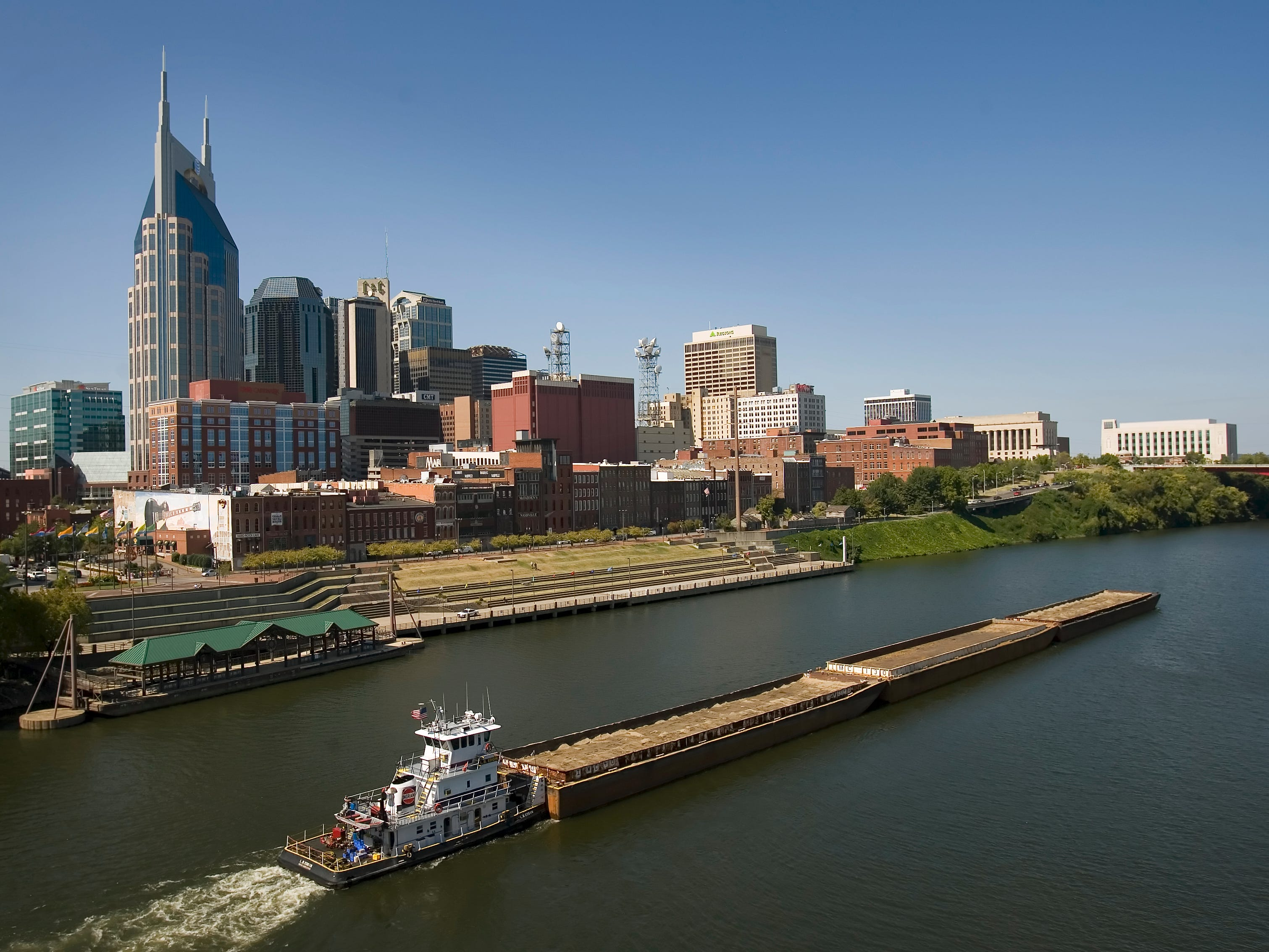 A tugboat pushes barges on the Cumberland River passing by the downtown Nashville skyline Oct. 1, 2008.