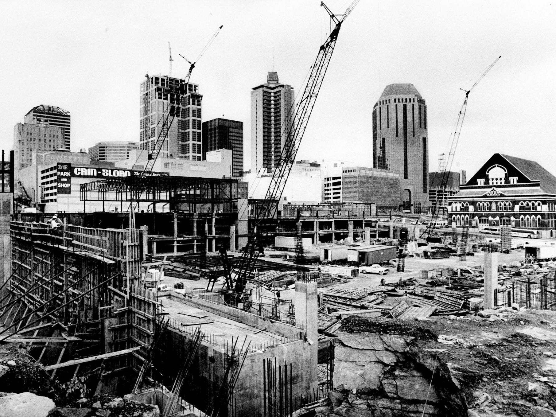 "The construction site of the downtown convention center is crowded with construction cranes Nov. 28, 1985, but soon the Center City Commission hopes that the center will act as an ""anchor,"" drawing merchants and shoppers to the area."