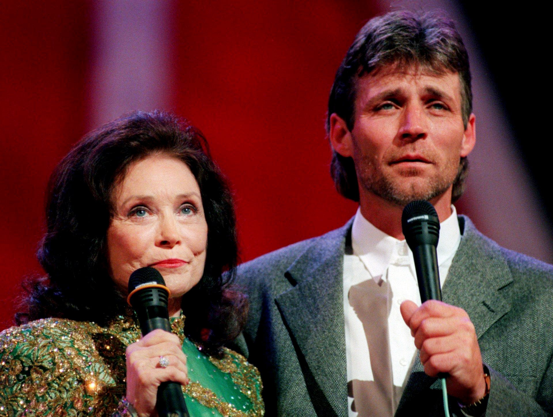 Loretta Lynn, left, is singing with her son, Ernie Lynn, during a special appearance at the Standard Candy part of the Saturday night program of the Grand Ole Opry at the Opry House May 2, 1998.