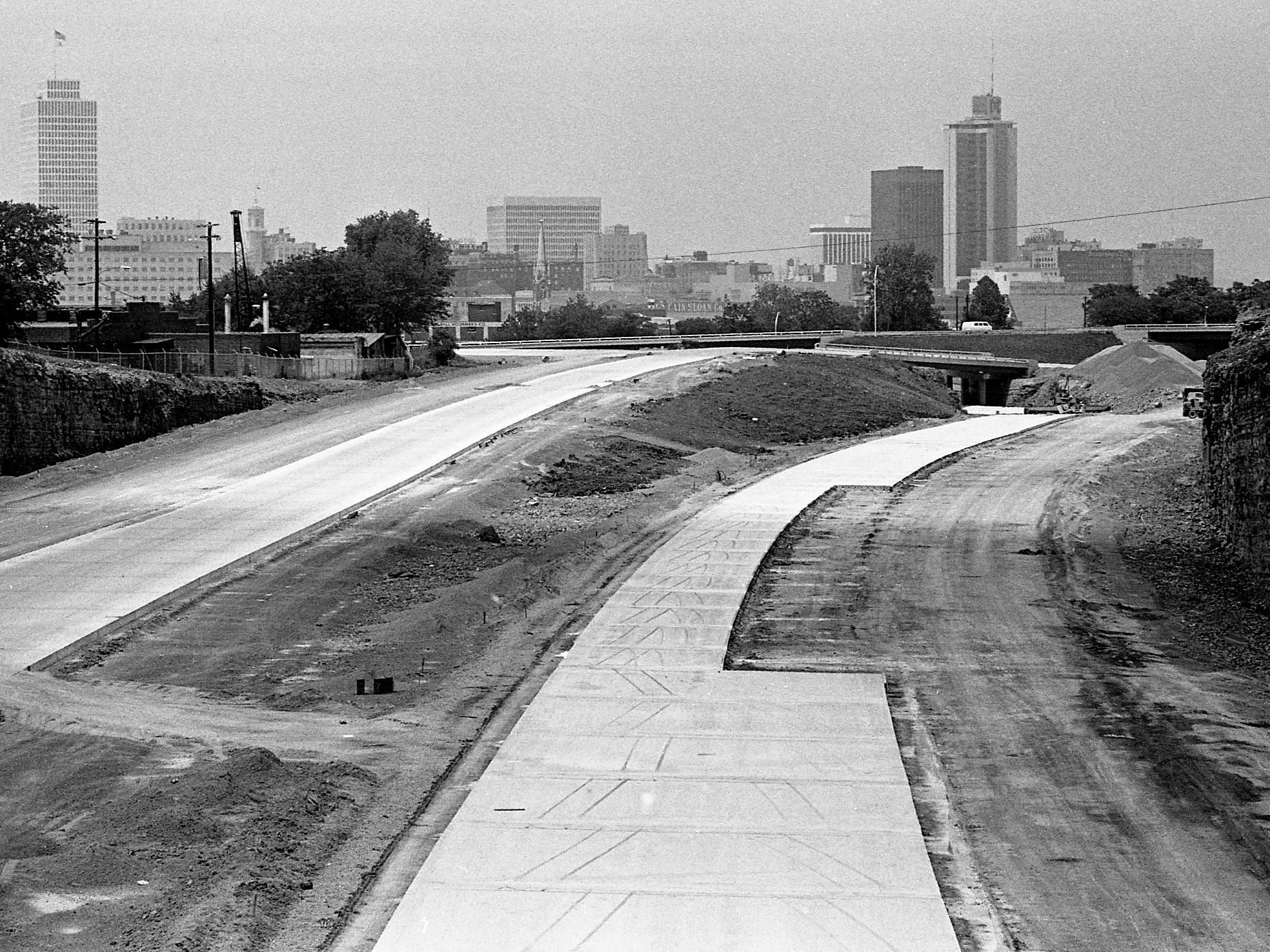 The growing Nashville skyline looms above a near-complete I-65 south of downtown Nashville. This view is from Chestnut Avenue overpass just south of the junction of I-65 and I-40 (the inter loop) on July 9, 1972.