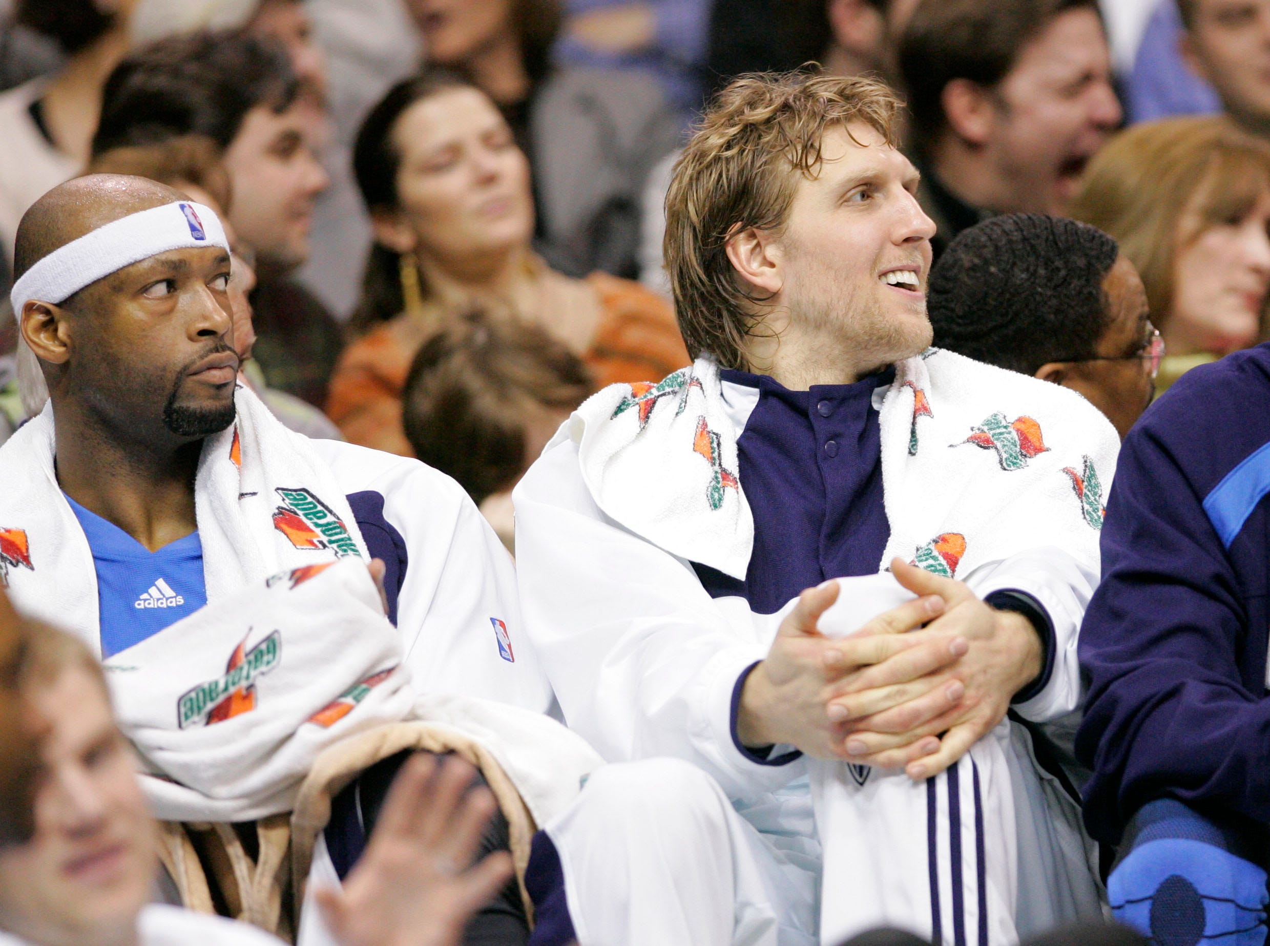 Dallas Mavericks starters Erick Dampier, left, Dirk Nowitzki, center, of Germany, and Jerry Stackhouse watch their NBA basketball game against the Portland Trail Blazers from the bench during the second half of the Mavericks' 99-74 win in Dallas, Wednesday, Jan. 10, 2007.