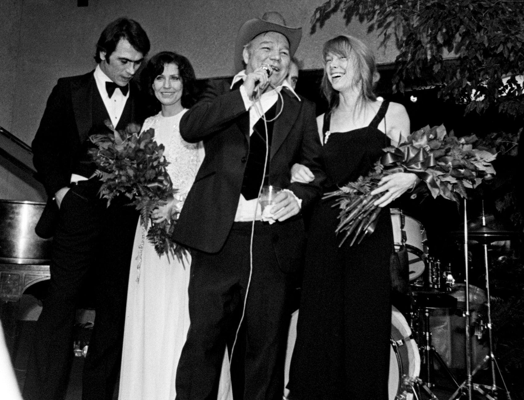 """At the cocktail reception held at Cheekwood's Botanic Hall after the movie premiere showing of """"Coal Miner's Daughter"""" March 4, 1984, Mooney Lynn, second from right, introduces his wife, Loretta Lynn, second from left, and actor Tommy Lee Jones, left, who plays Mooney, and actress Sissy Spacek, right, who stars as Loretta."""